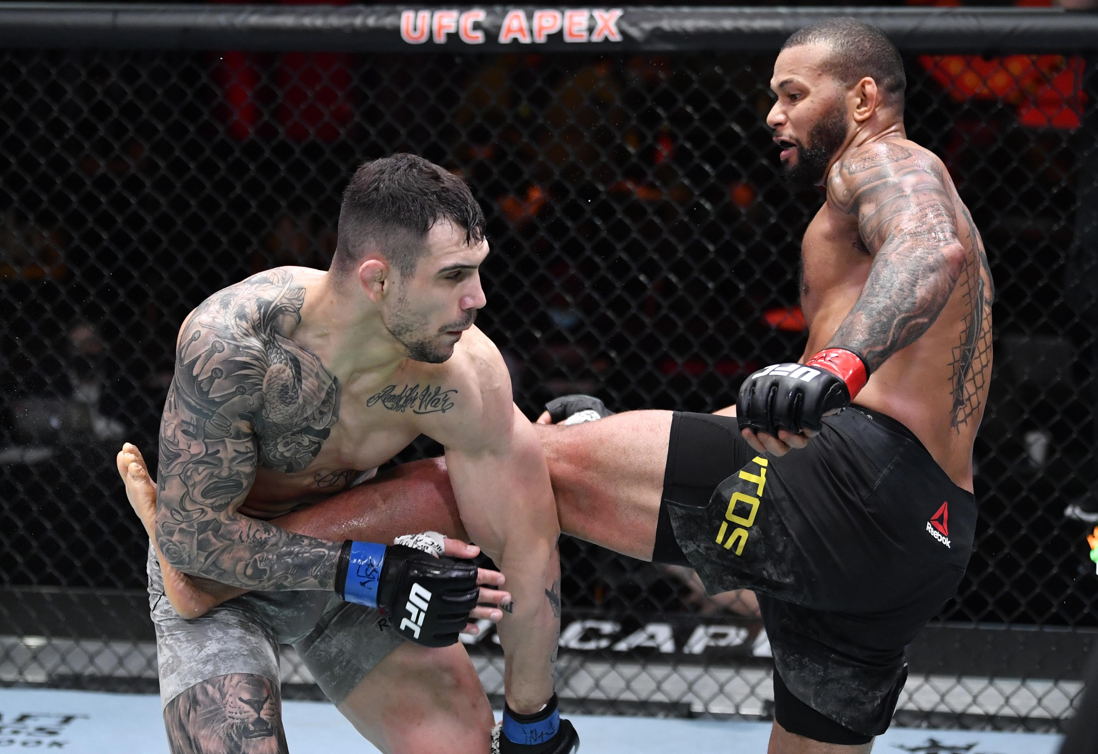 Thiago Santos of Brazil kicks Aleksandar Rakic of Austria in their light heavyweight fight during the UFC 259 event at UFC APEX on March 06, 2021 in Las Vegas, Nevada