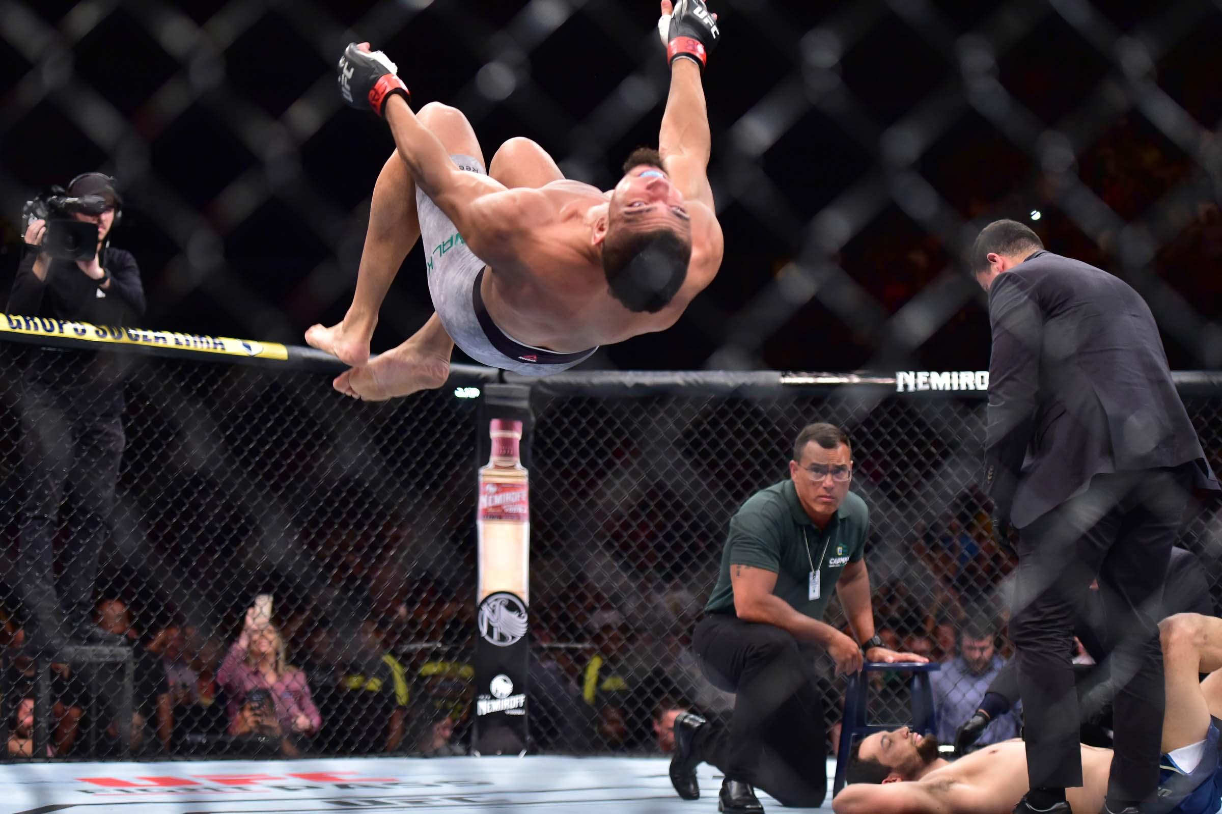 Johnny Walker (red gloves) reacts to fight against Justin Ledet (blue gloves) during UFC Fight Night at Arena CFO