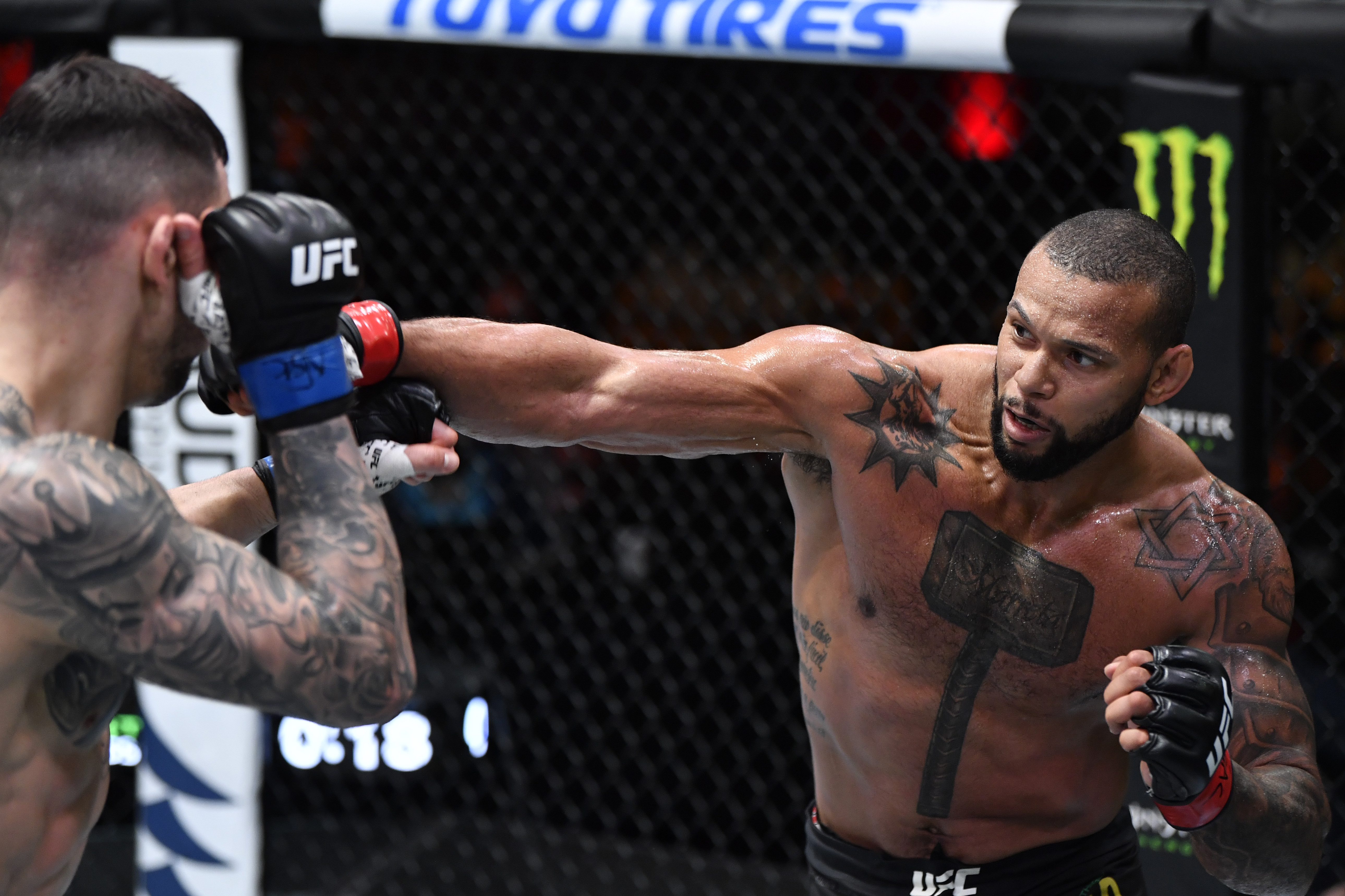 Thiago Santos of Brazil punches Aleksandar Rakic of Austria in their light heavyweight fight during the UFC 259 event at UFC APEX on March 06, 2021 in Las Vegas, Nevada