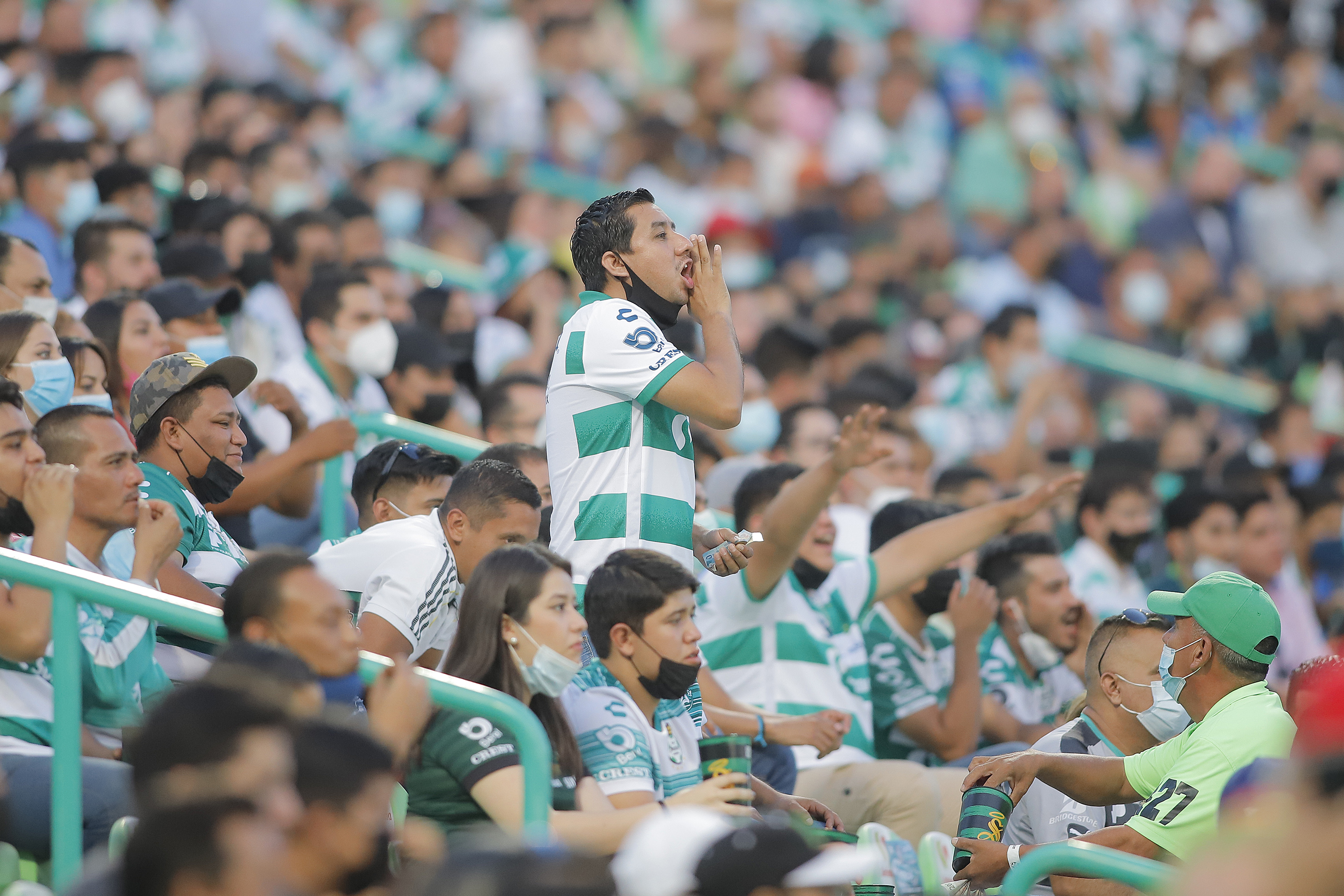Fans of Santos shout during the 10th round match between Santos Laguna and Monterey as part of the Torneo Grita Mexico A21 Liga MX at Corona Stadium on September 26, 2021 in Torreon, Mexico.