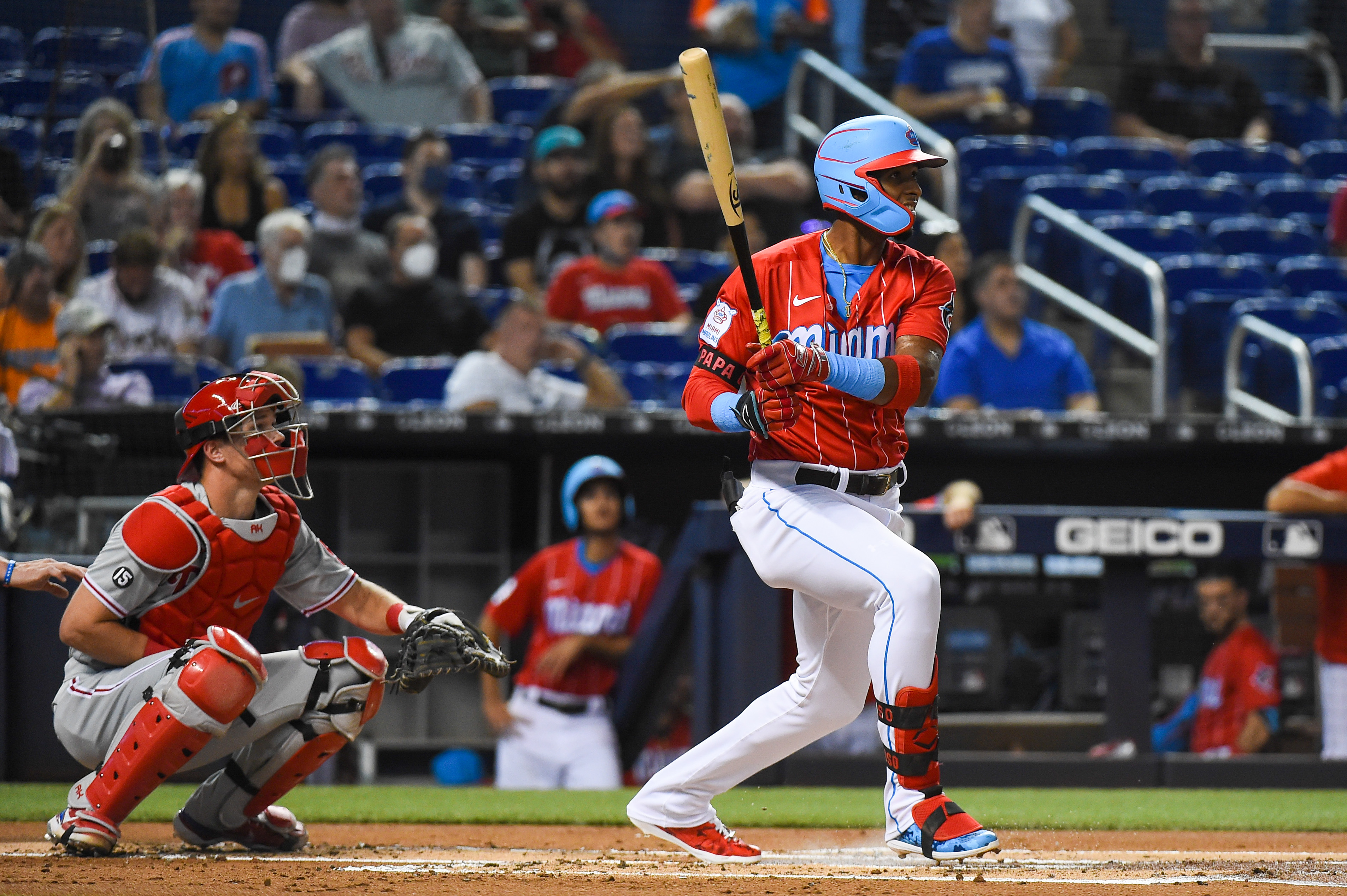 Lewin Diaz #68 of the Miami Marlins singles during the first inning against the Philadelphia Phillies at loanDepot park