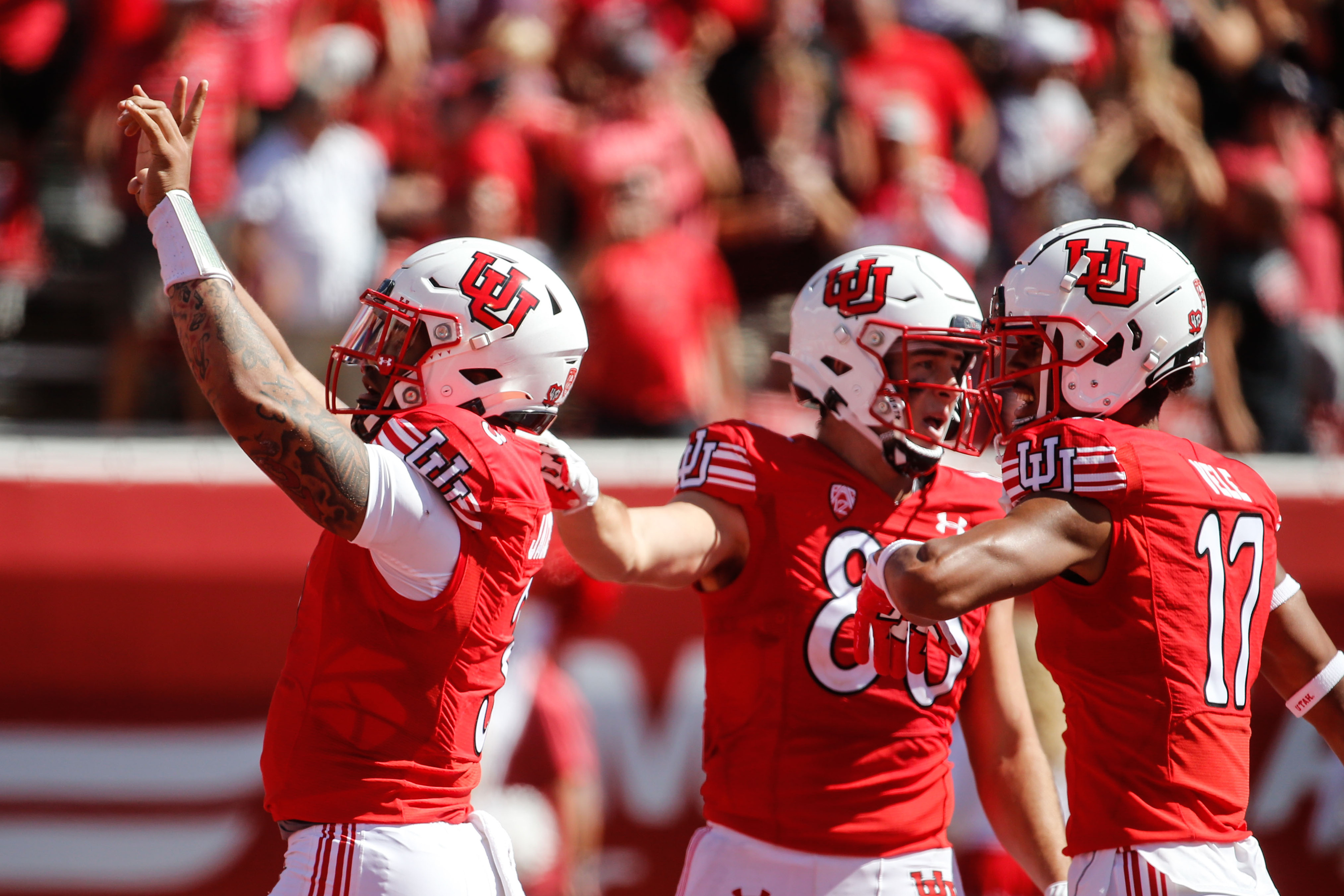 Utah quarterback Ja'Quinden Jackson, left, celebrates with his teammates after their first touchdown during an NCAA college football game against Washington State at Rice-Eccles Stadium on Saturday, Sept. 25, 2021 in Salt Lake City.