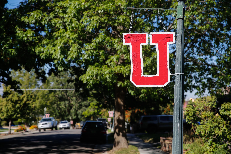 "A ""U"" sign hangs in the Salt Lake City neighborhood near where University of Utah football player back Aaron Lowe was killed."