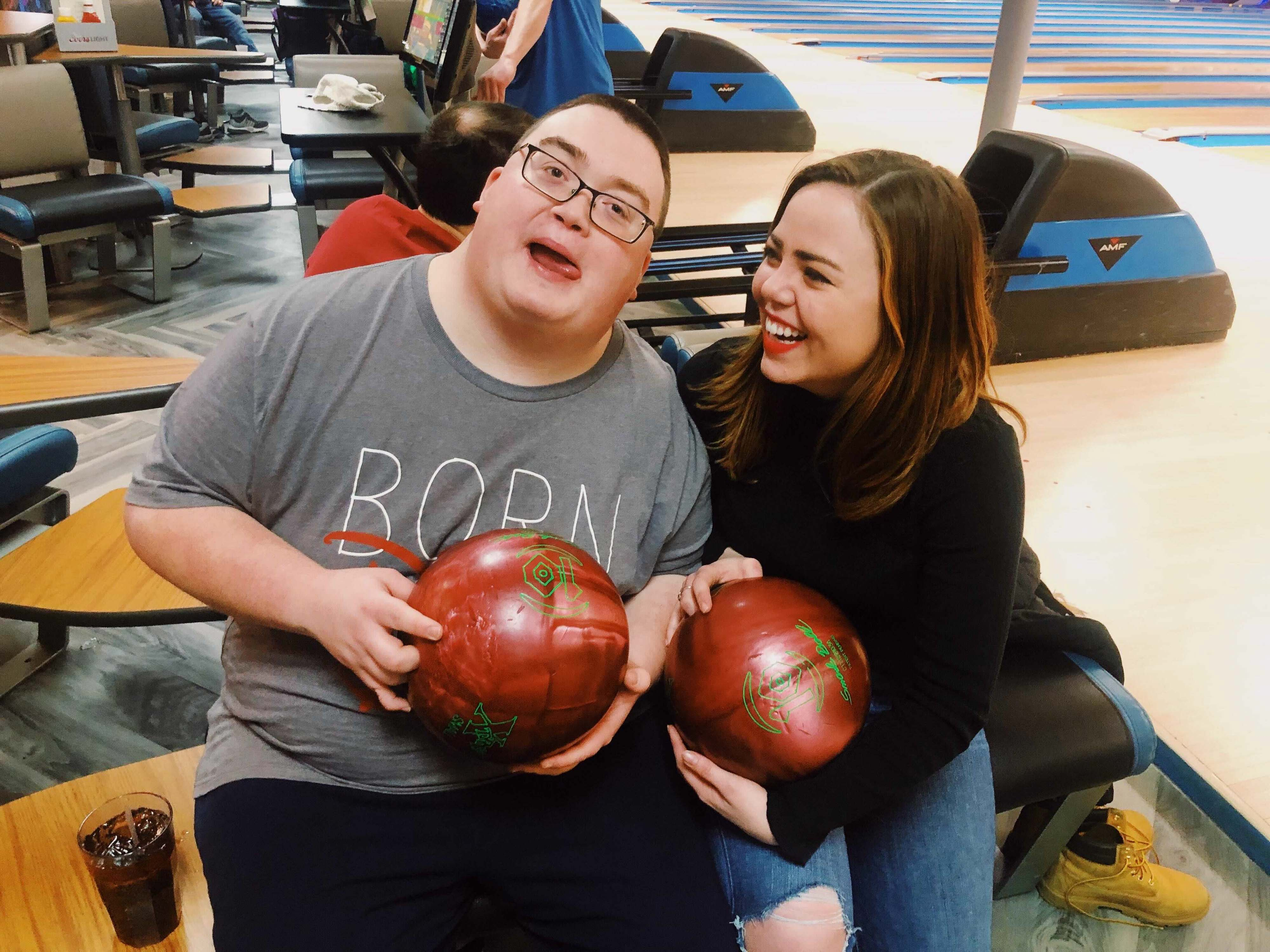 Samantha West, Chalkbeat Tennessee's new reporter, poses for a photo with her older brother, Alex, while bowling in January 2019.