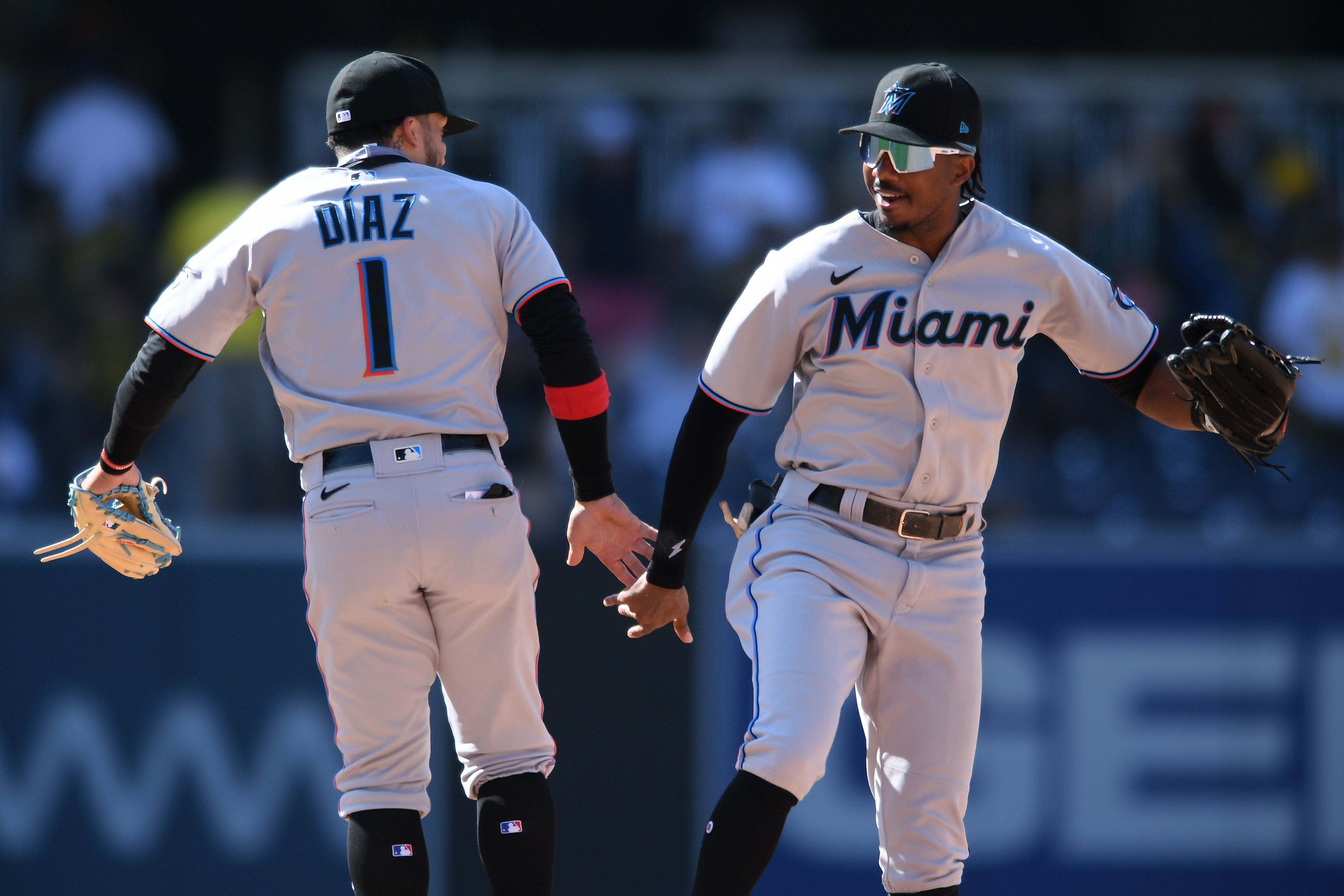 Miami Marlins center fielder Lewis Brinson (right) and second baseman Isan Diaz (1) celebrate on the field after defeating the San Diego Padres at Petco Park