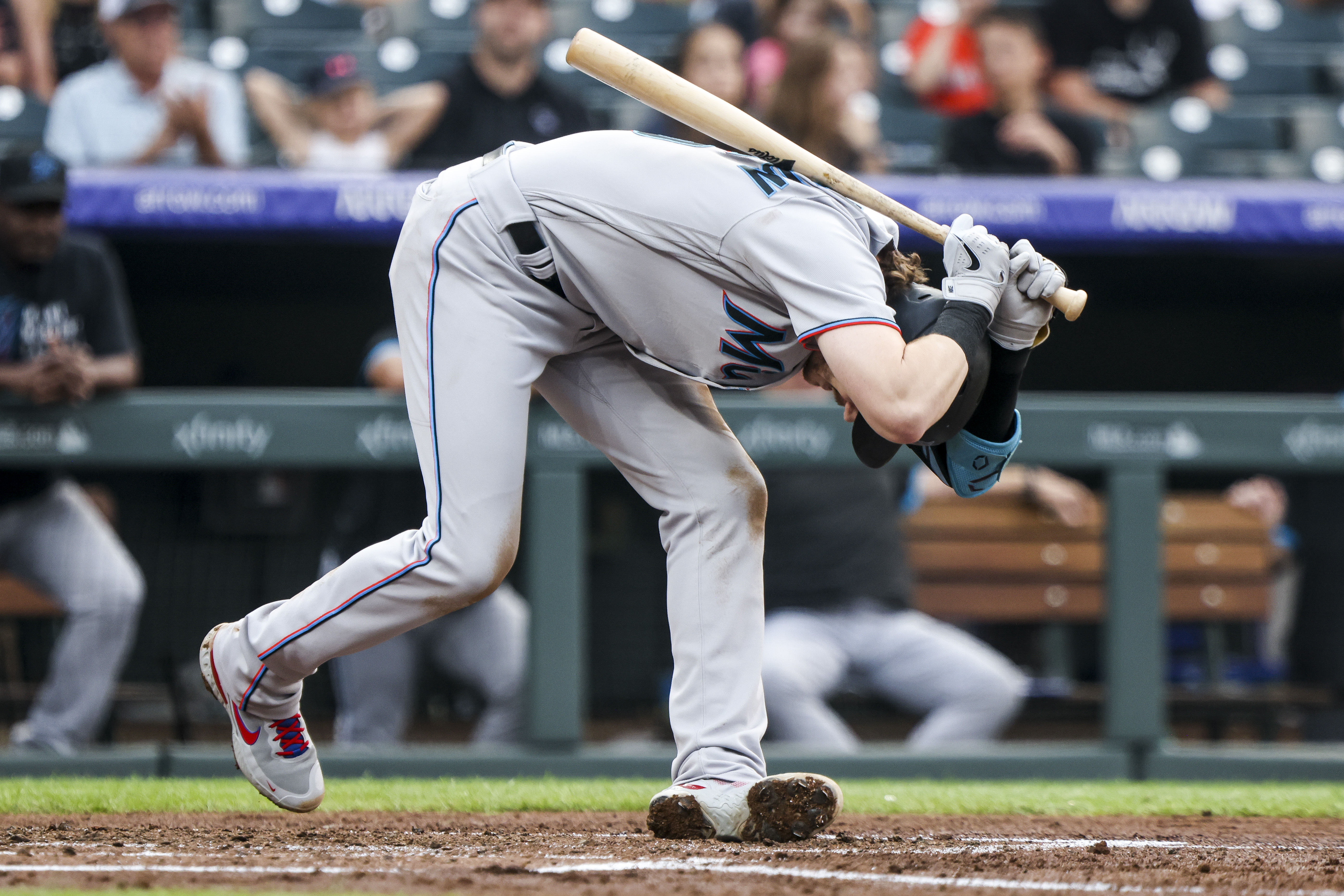 Miami Marlins third baseman Brian Anderson (15) reacts after striking out against the Colorado Rockies in the third inning at Coors Field