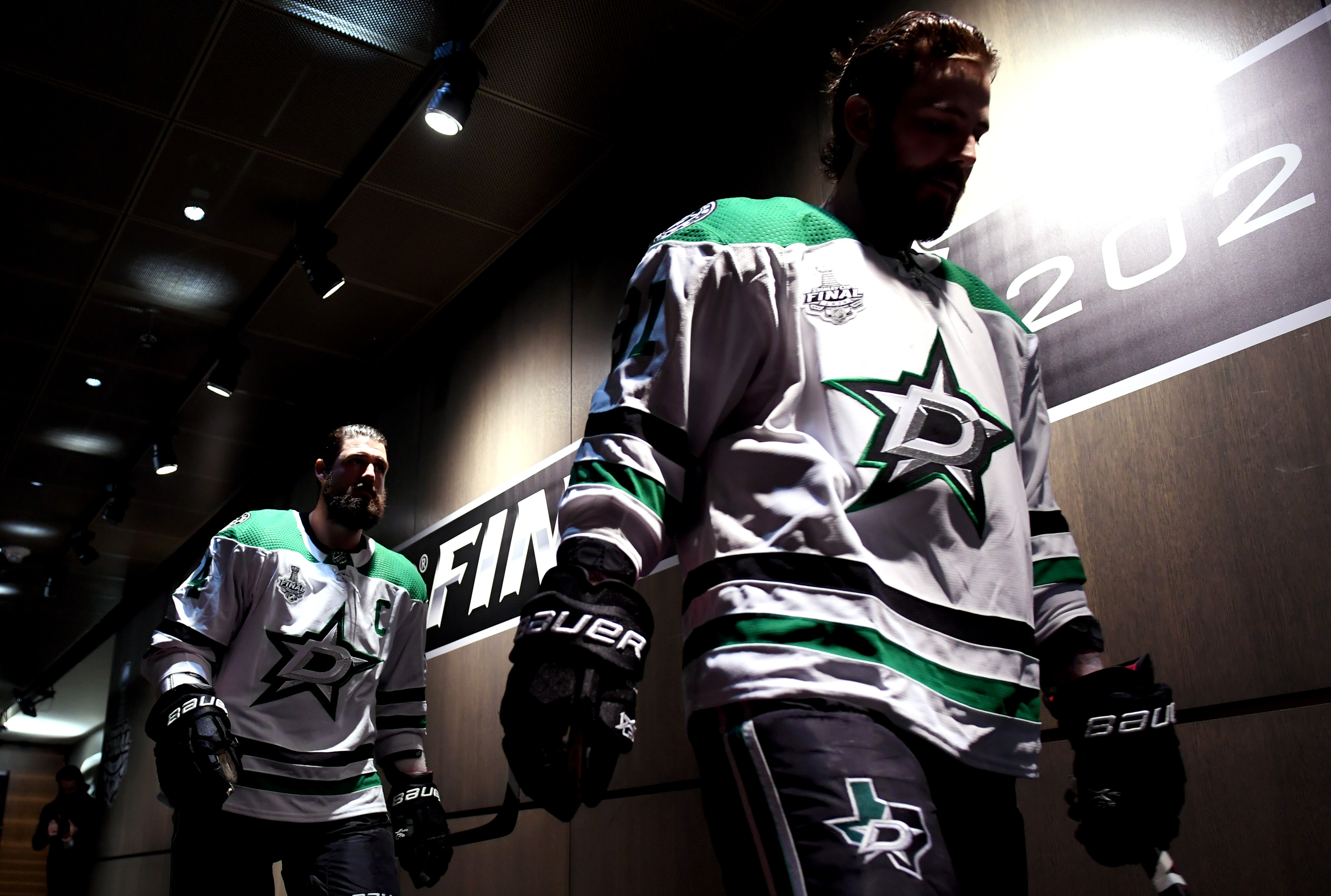 Jamie Benn and Tyler Seguin walk toward the ice before Game One of the Stanley Cup Finals versus the Tampa Bay Lightning at Rogers Place in Edmonton.