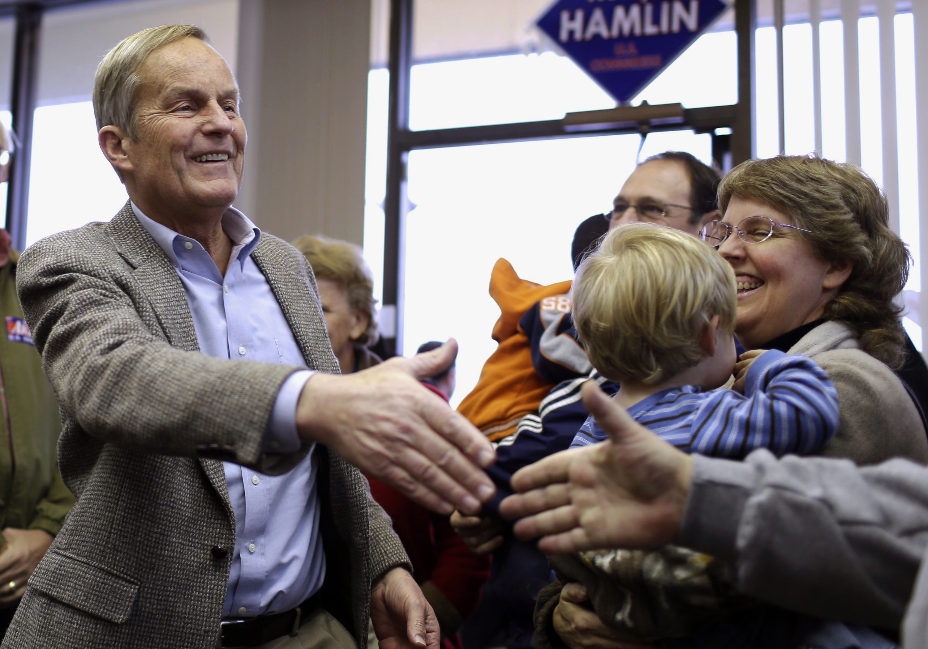 """In this Nov. 5, 2012, file photo, Todd Akin, then a Missouri Republican Senate candidate, campaigns in Florissant, Mo. Akin, whose """"legitimate rape"""" comments during the 2012 U.S. Senate campaign were roundly criticized has died. He was 74."""