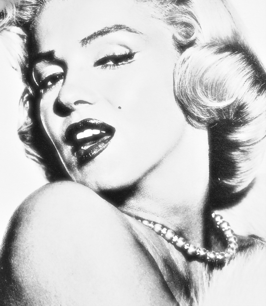A closeup of Marilyn Monroe's face