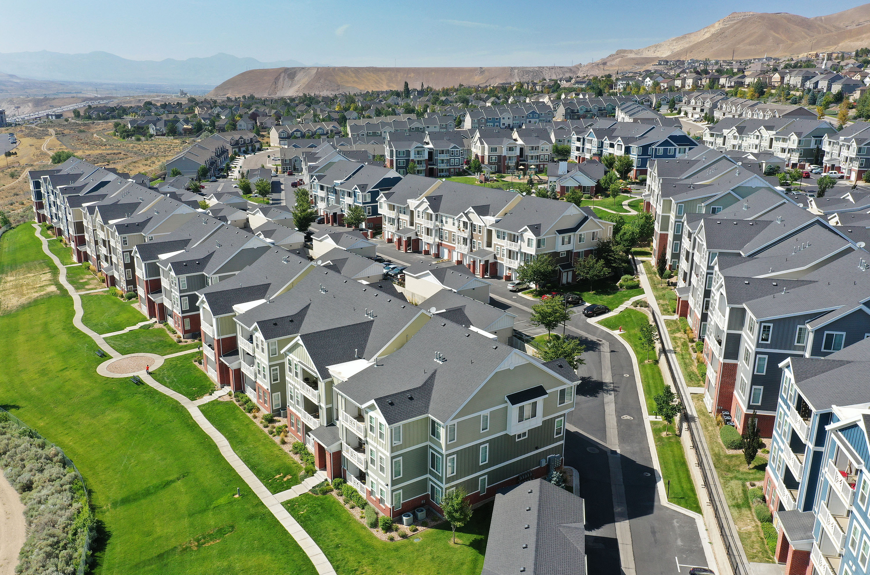 Apartments and town houses on Traverse Mountain Boulevard in Lehi are pictured on Aug. 11, 2021.