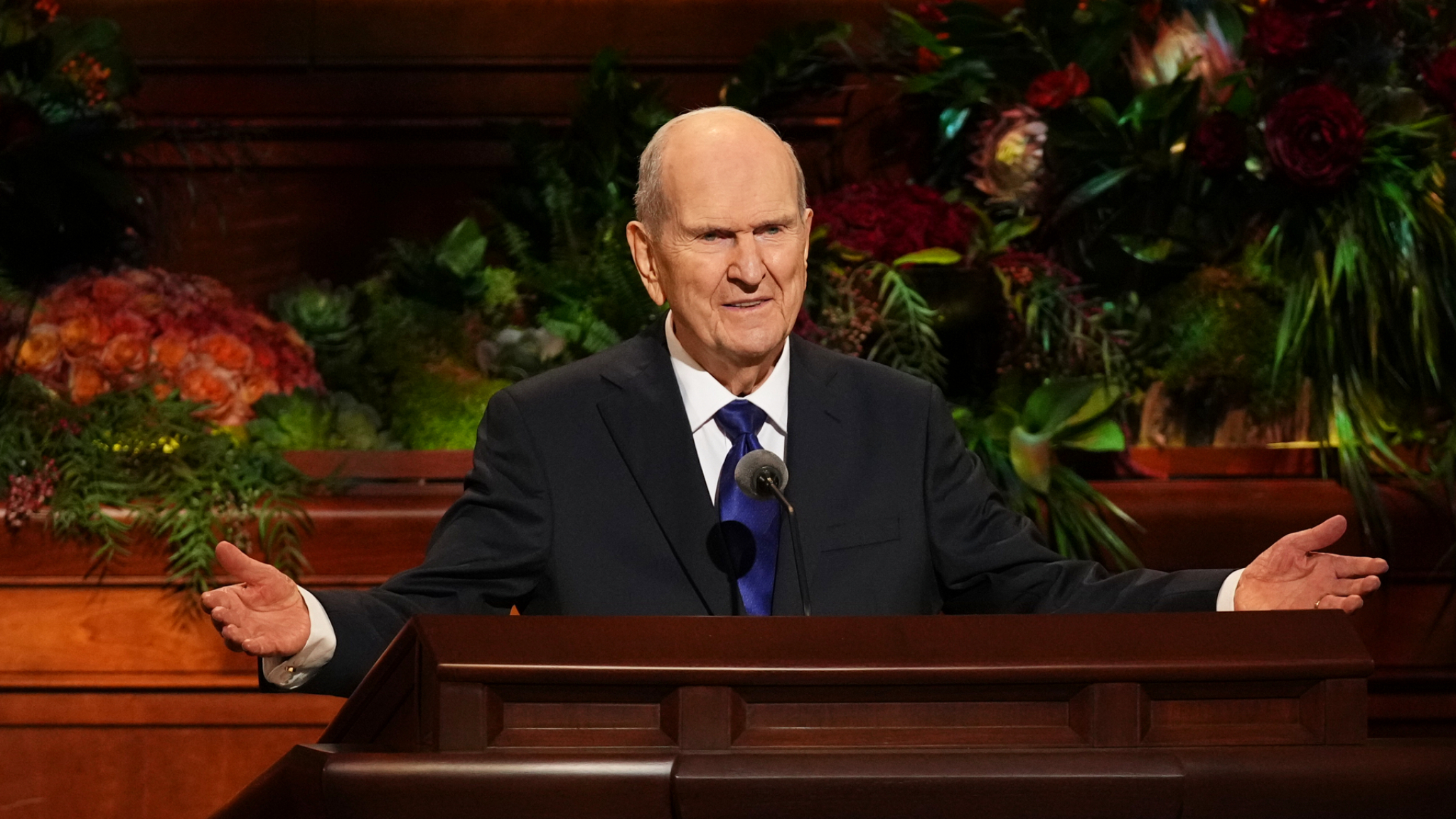 President Russell M. Nelson stands at the pulpit and announces plans for 13 new temples to be built.