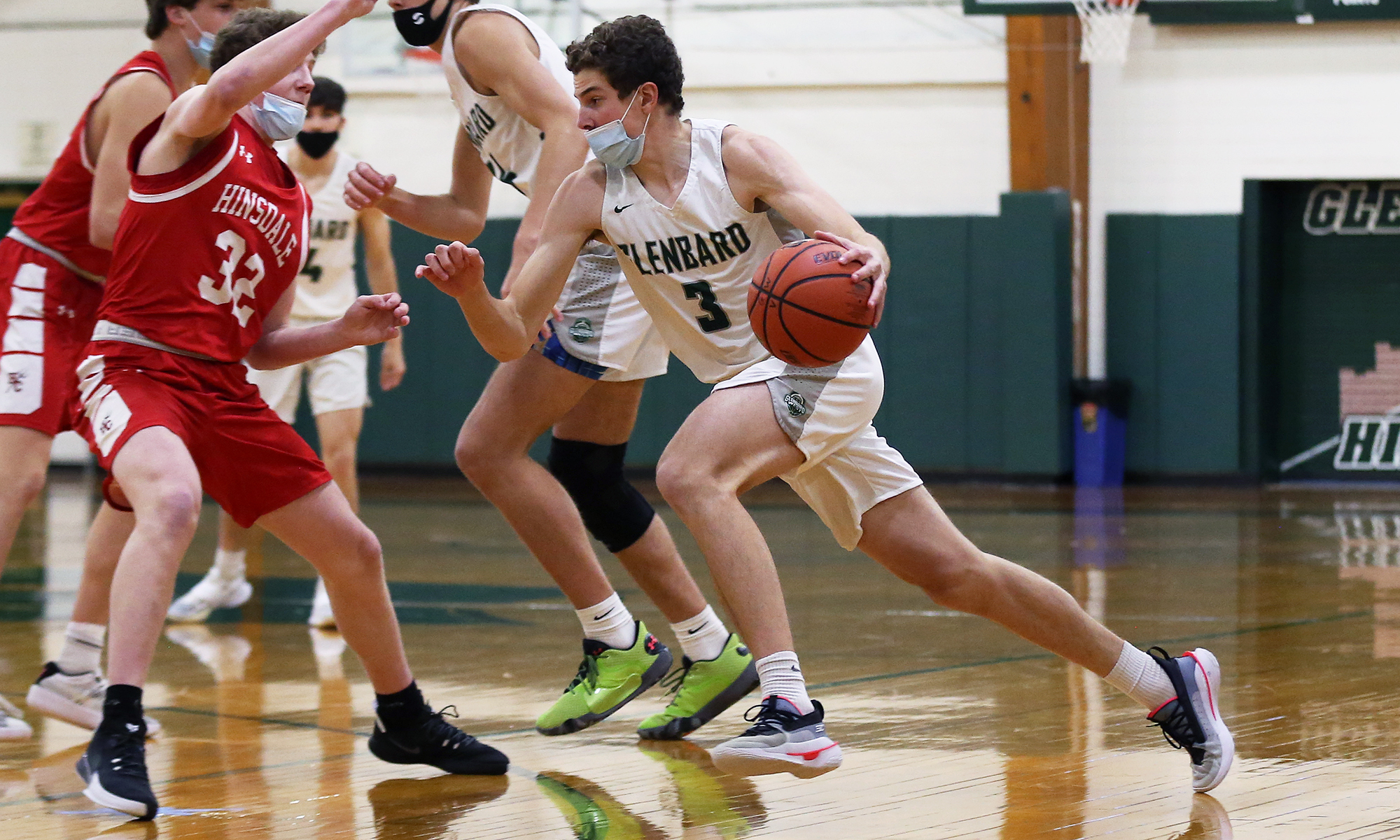 Glenbard West's Caden Pierce (3) pushes the tempo as Hinsdale Central's Jake Quast (32) defends.