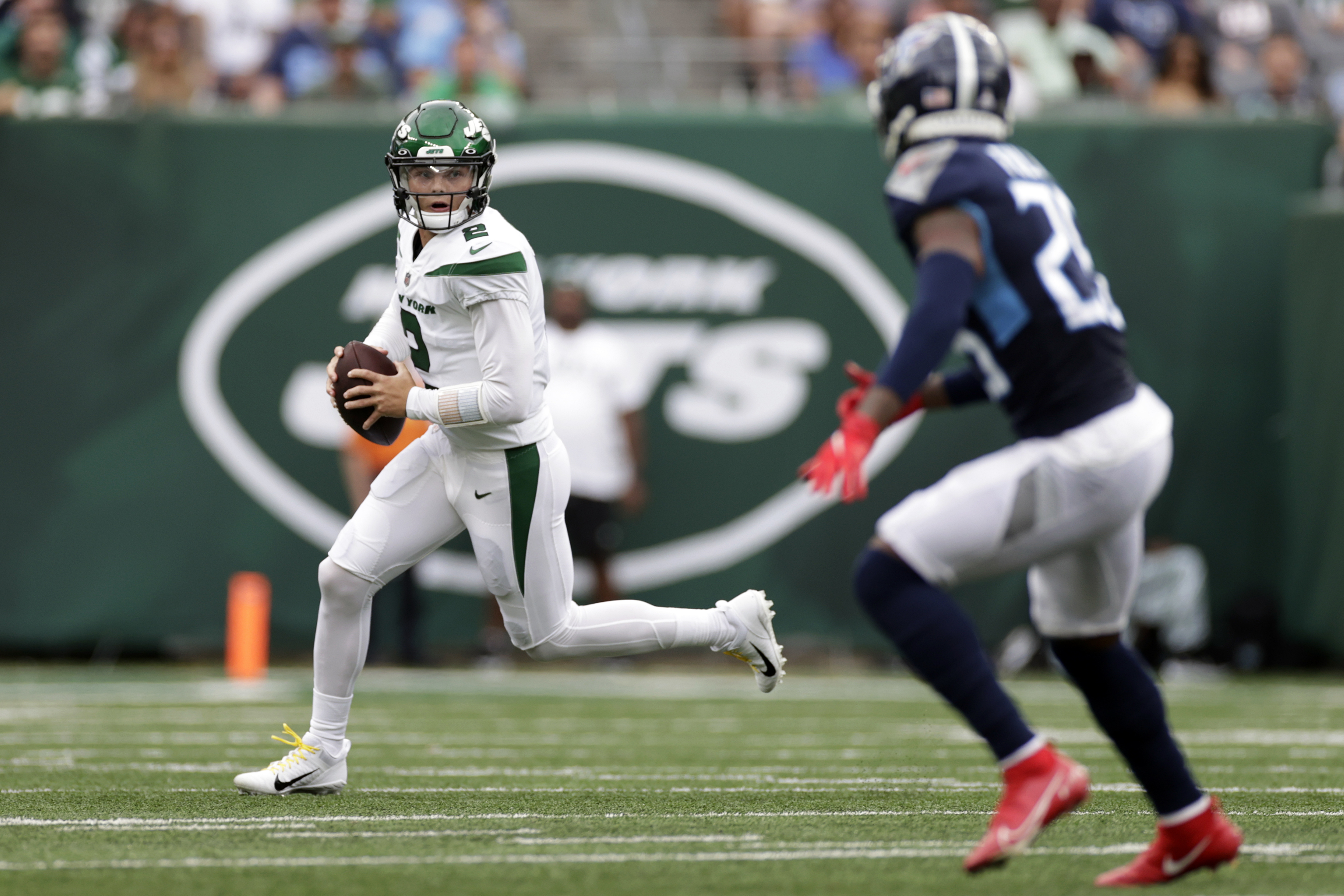 New York Jets quarterback Zach Wilson (2) passes against the Tennessee Titans.
