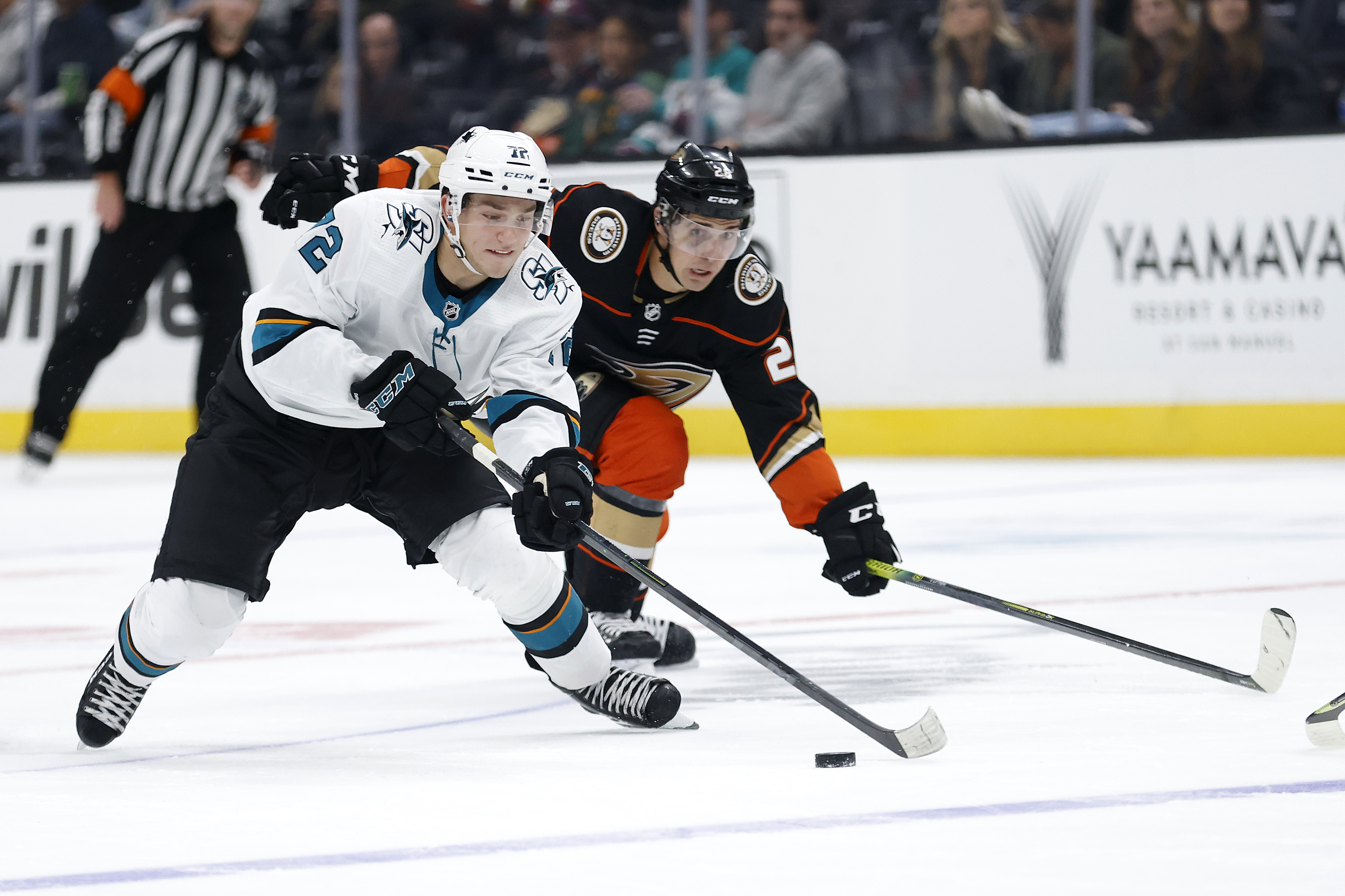 William Eklund #72 of the San Jose Sharks skates past Vinni Lettieri #28 of the Anaheim Ducks during the third period of a game at Honda Center on September 30, 2021 in Anaheim, California.