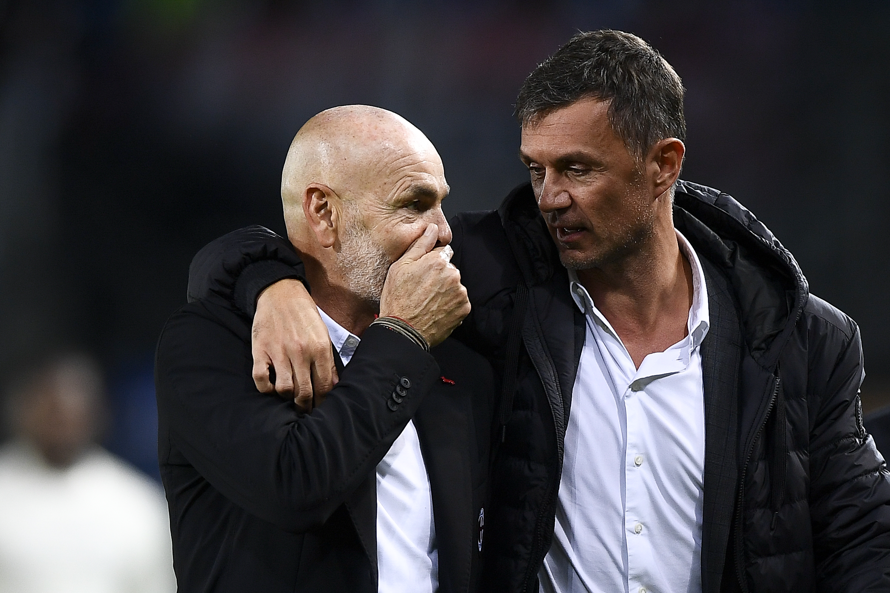 Stefano Pioli (L), head coach of AC Milan, speaks with Paolo...
