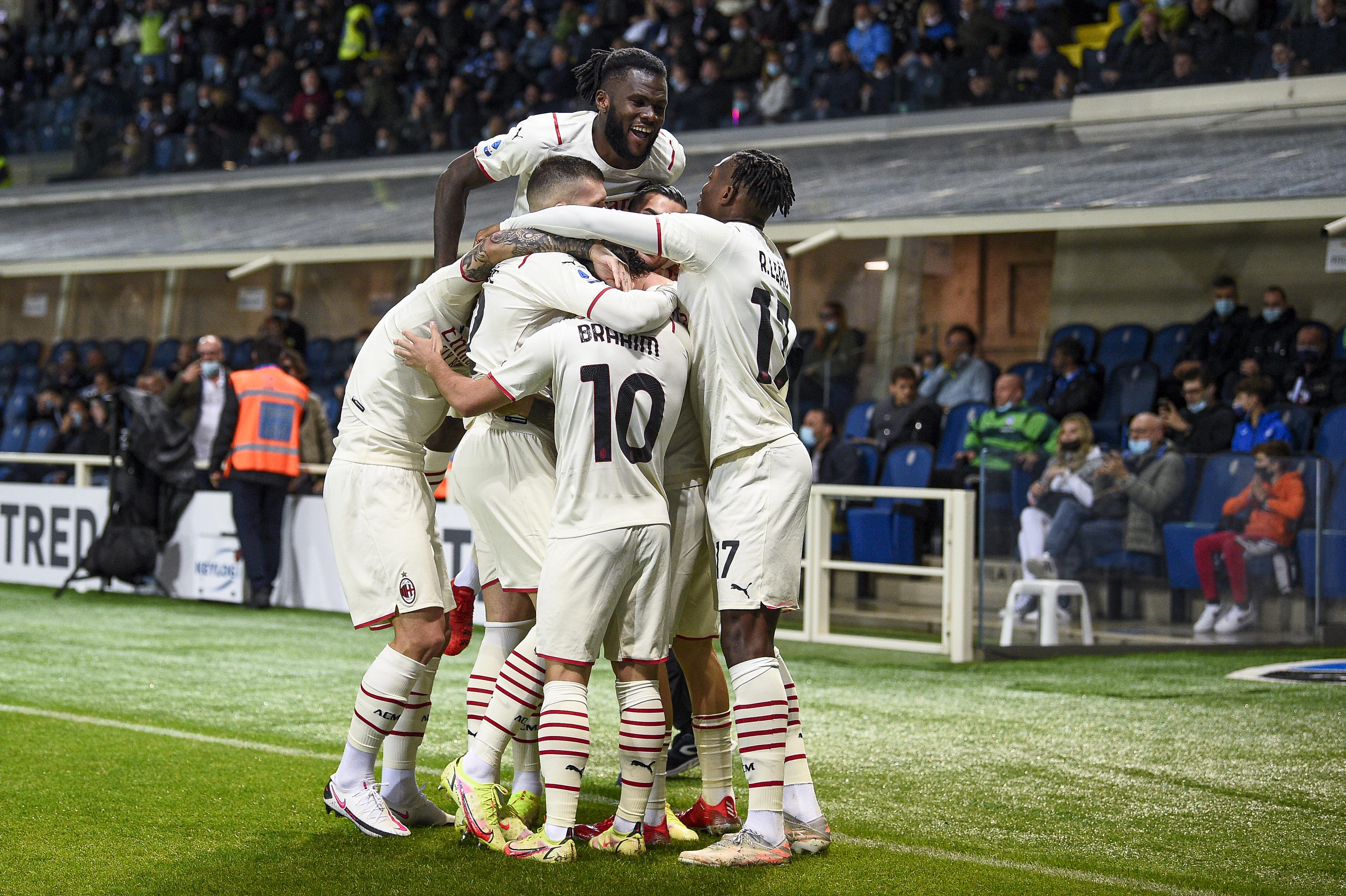 Davide Calabria of AC Milan celebrates with his teammates...