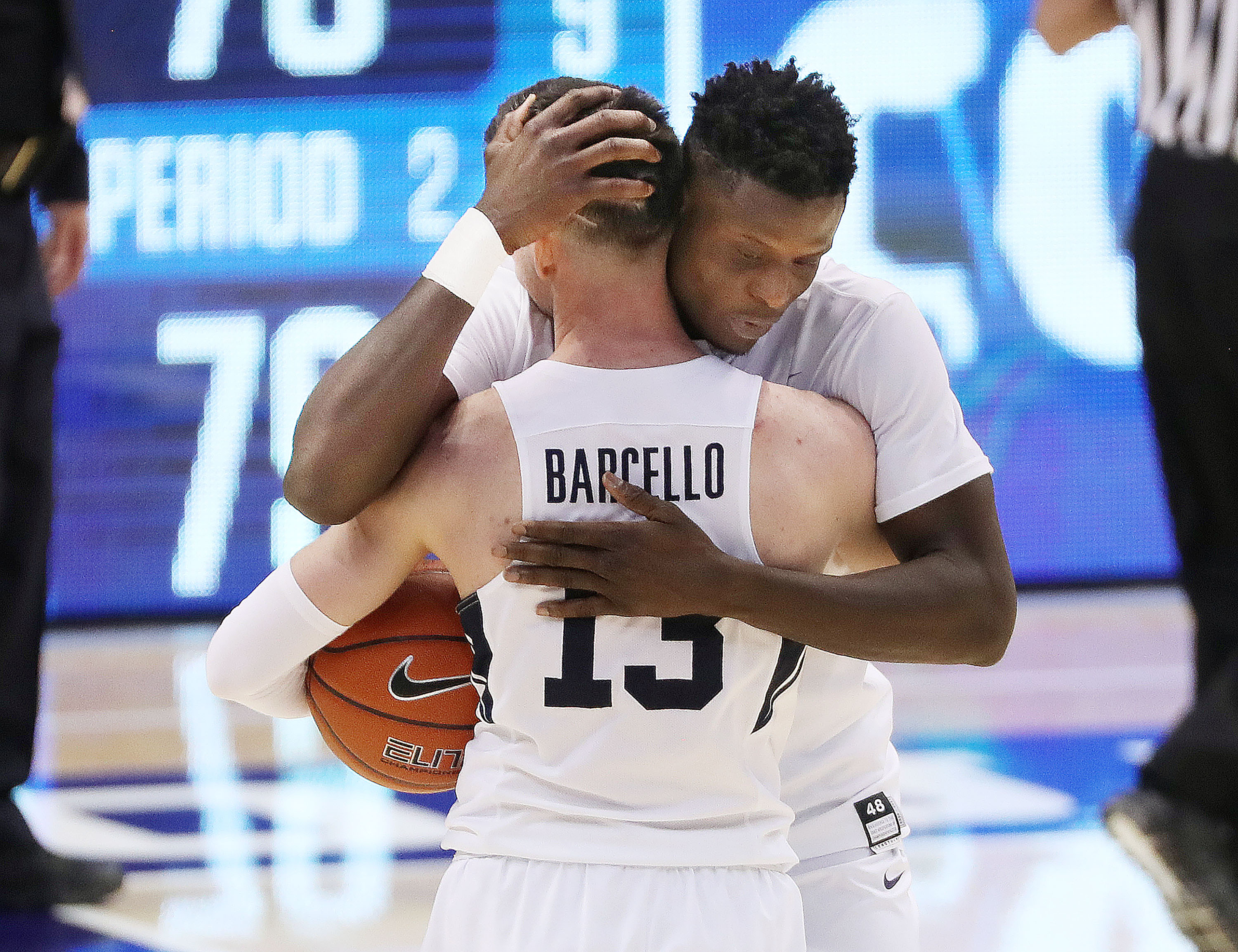 Brigham Young Cougars guard Alex Barcello (13) and Brigham Young Cougars forward Gideon George (5) hug after beating the San Francisco Dons in Provo on Thursday, Feb. 25, 2021. BYU won 79-73.
