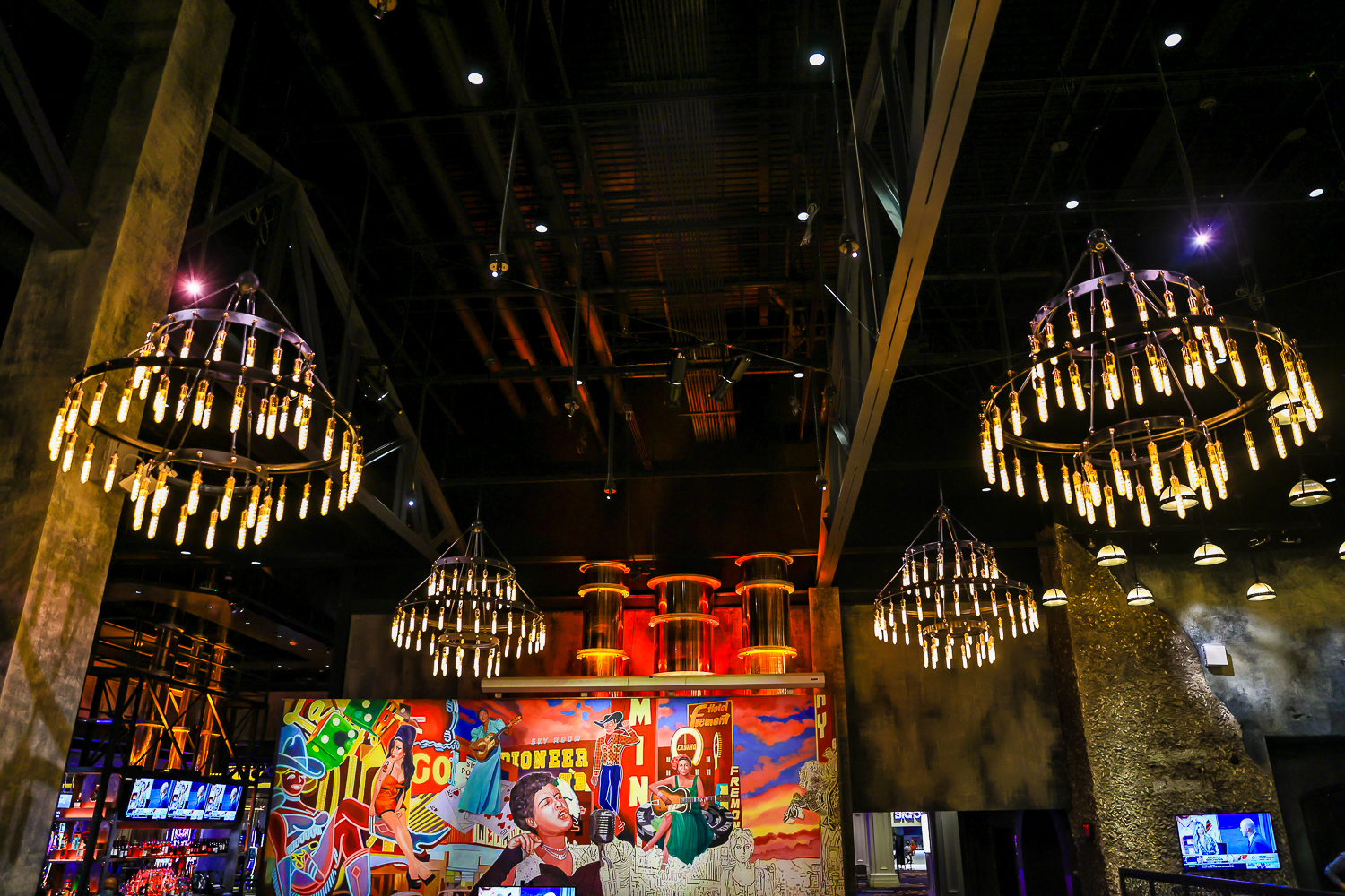 A colorful mural with chandeliers on either side at House of Blues