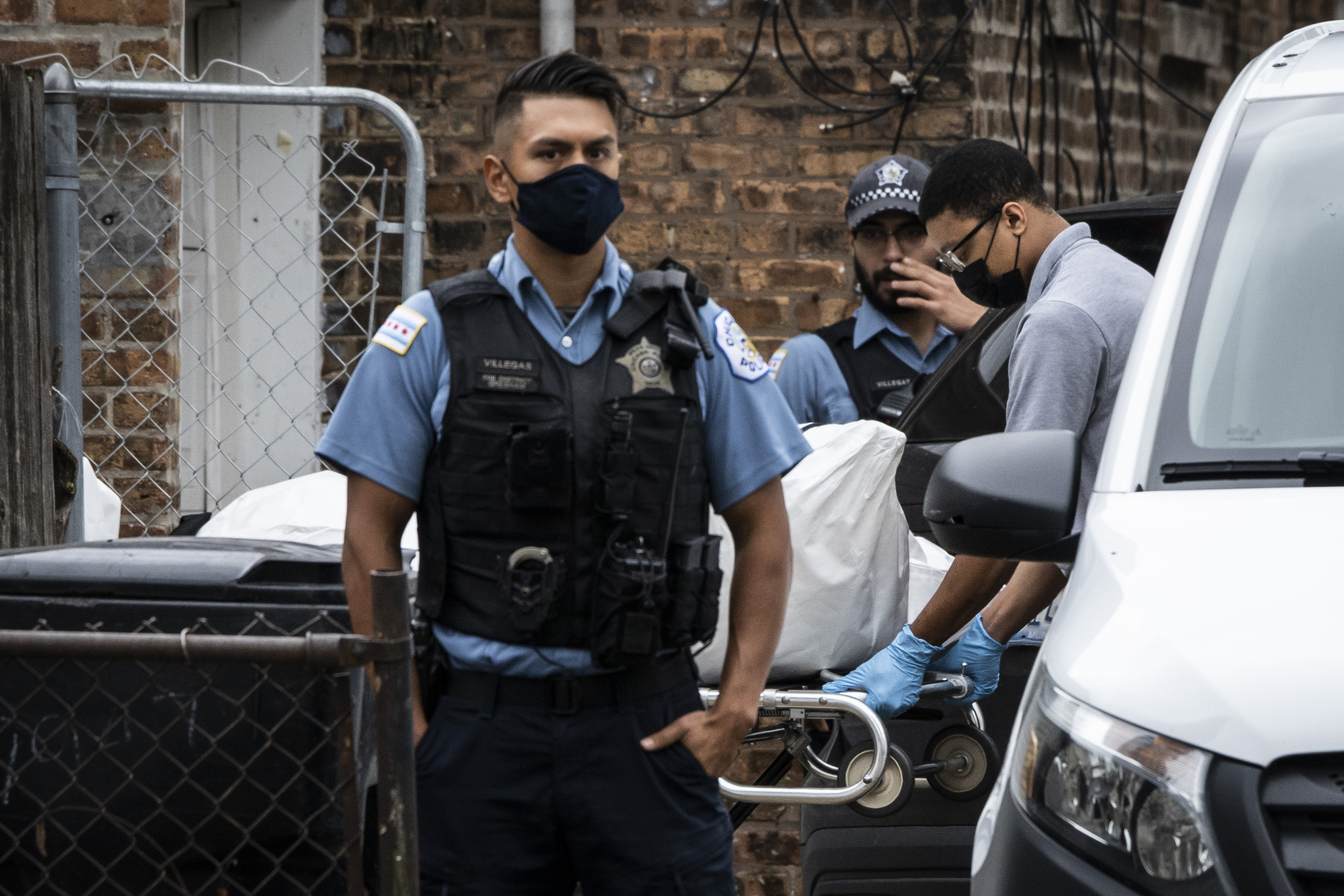 A crew removes a body from an apartment in the 7700 block of South Carpenter Street after a Chicago police officer shot and killed a man while answering a call of a domestic disturbance in the Gresham building on the South Side, Monday morning, Oct. 4, 2021.