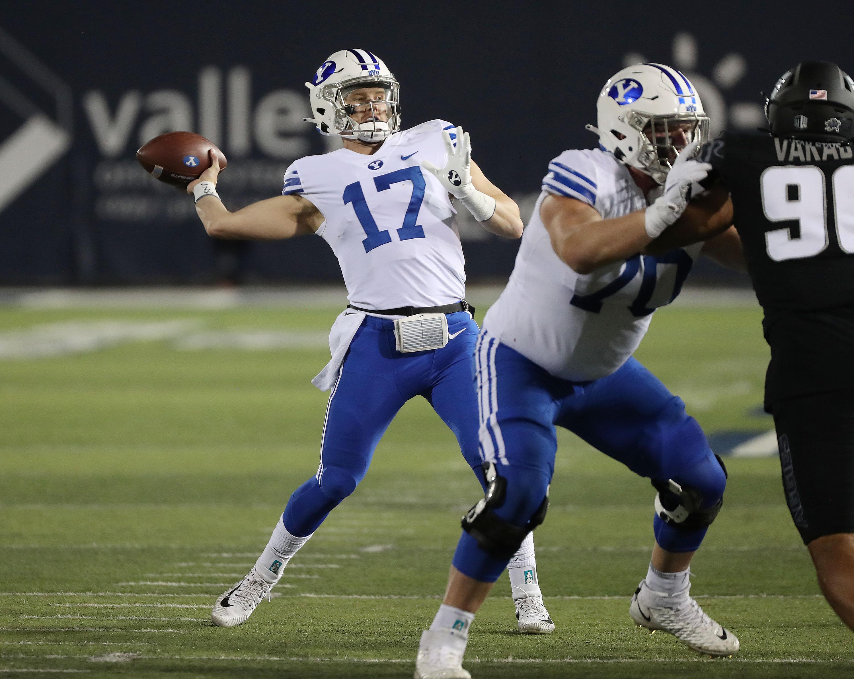 BYU quarterback Jacob Conover (17) throws against the Utah State Aggies.