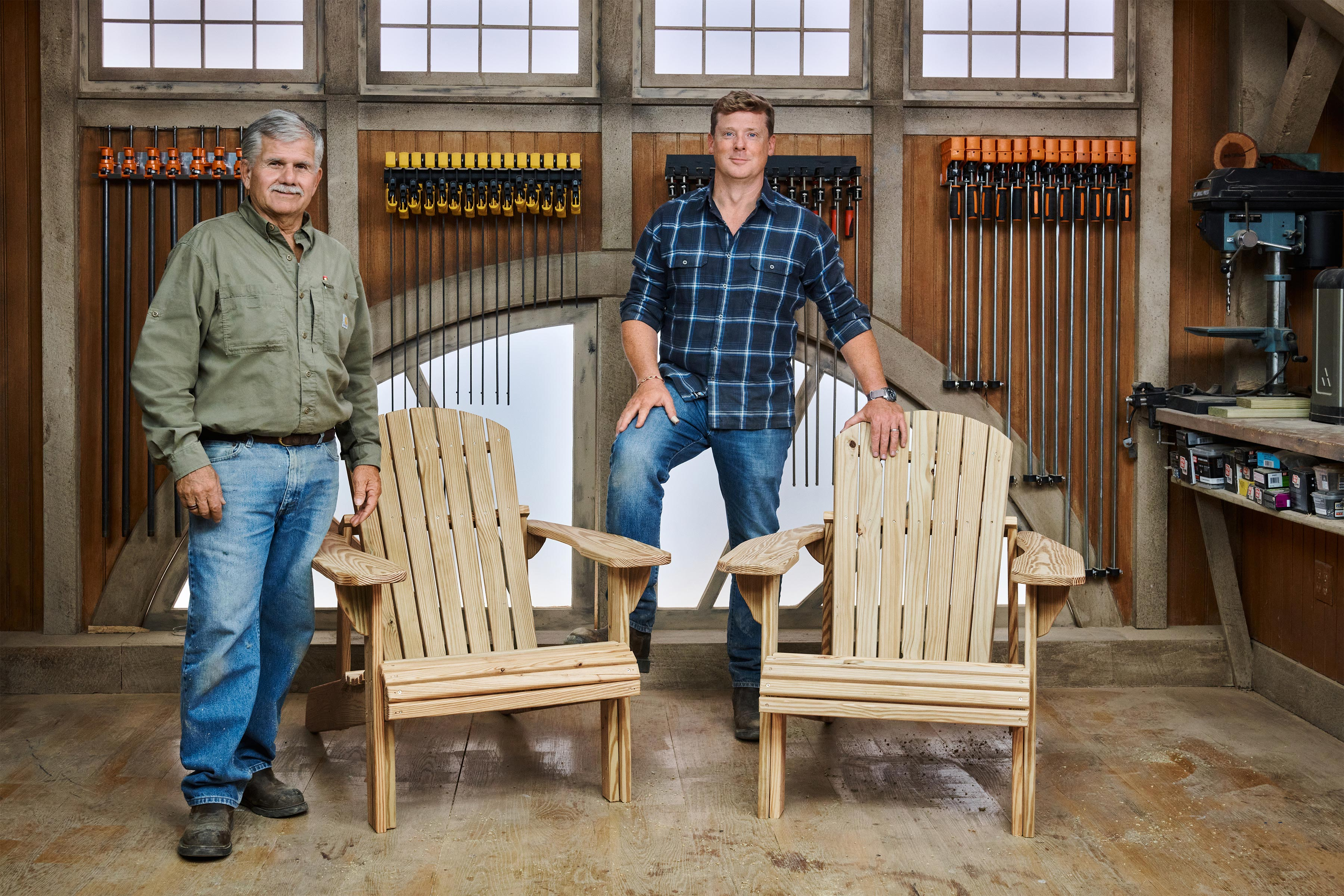 Kevin O'Connor and Tom Silva stand next to two Adirondack chairs they made for ASK This Old House.