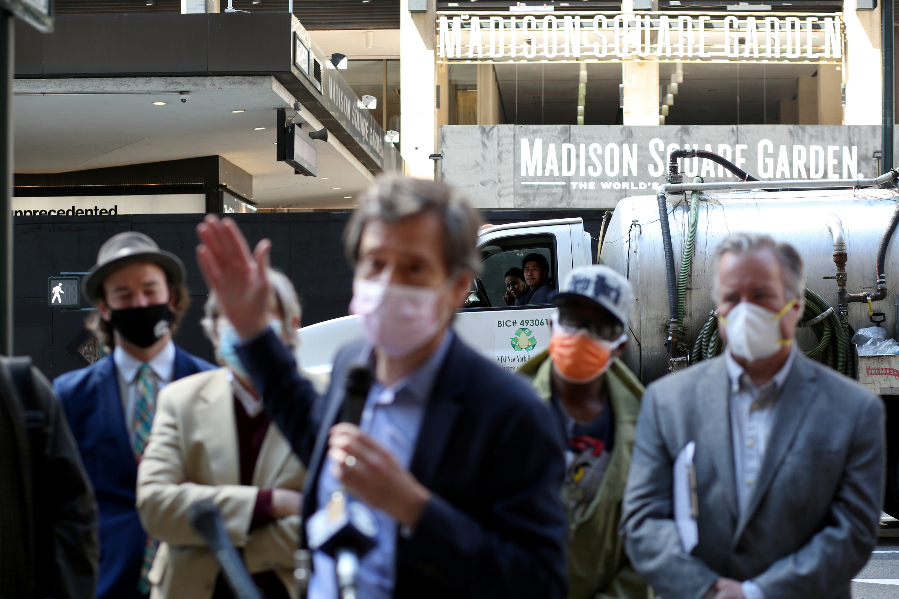 Motorists look on as New York State Senator Brad Hoylman speaks at a news conference for transit advocates, civic groups and residents in protest of Governor Andrew Cuomo's Empire Station Complex in Manhattan, on April 7, 2021.
