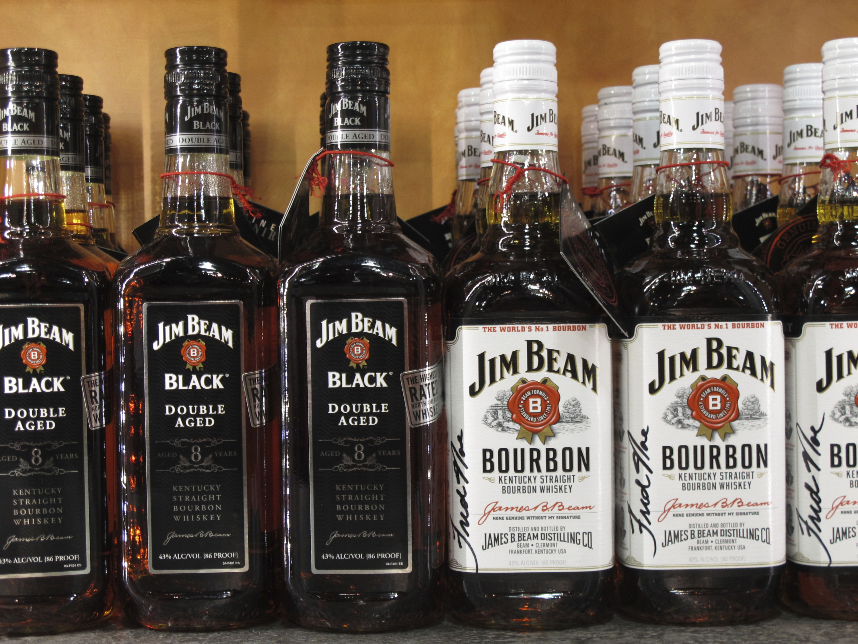 Jim Beam bottles line the counter at the Jim Beam visitors' center at Clermont, Ky. Kentucky's bourbon industry is showing that it's increasingly bullish on its future. The industry has reached new production heights despite the COVID-19 pandemic and trade disputes in key European markets.