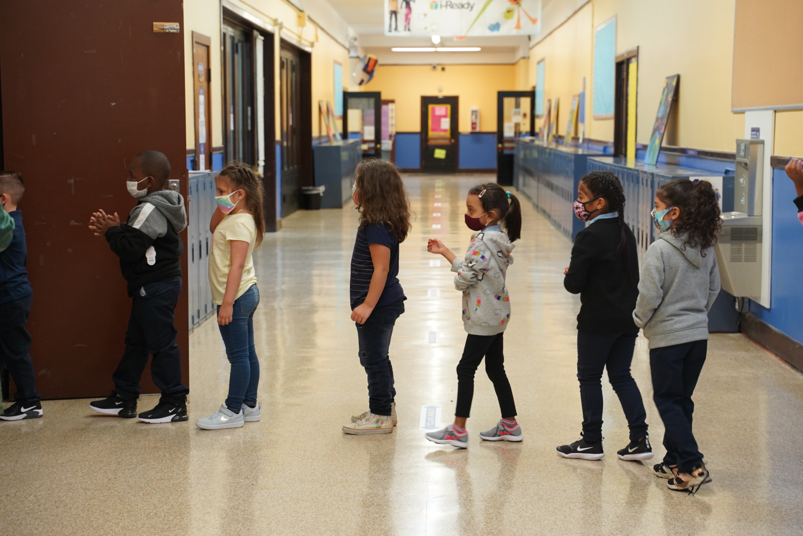Students at a Detroit elementary school line up as they walk through the hallways.