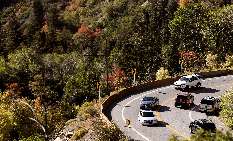 Vehicles drive through Big Cottonwood Canyon in Salt Lake City on Friday, Oct. 1, 2021.