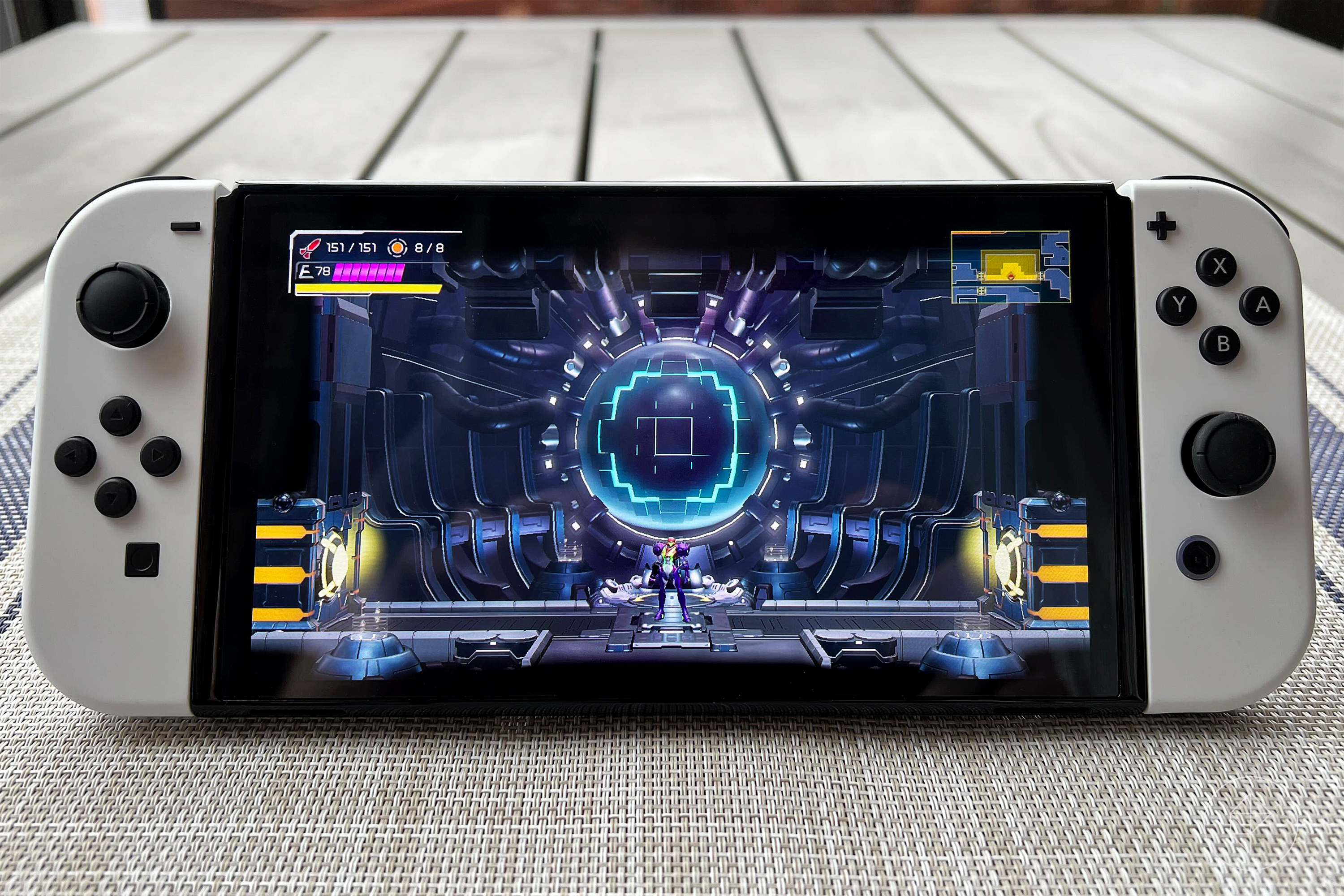 Metroid Dread on an OLED Nintendo Switch with white Joy-Cons