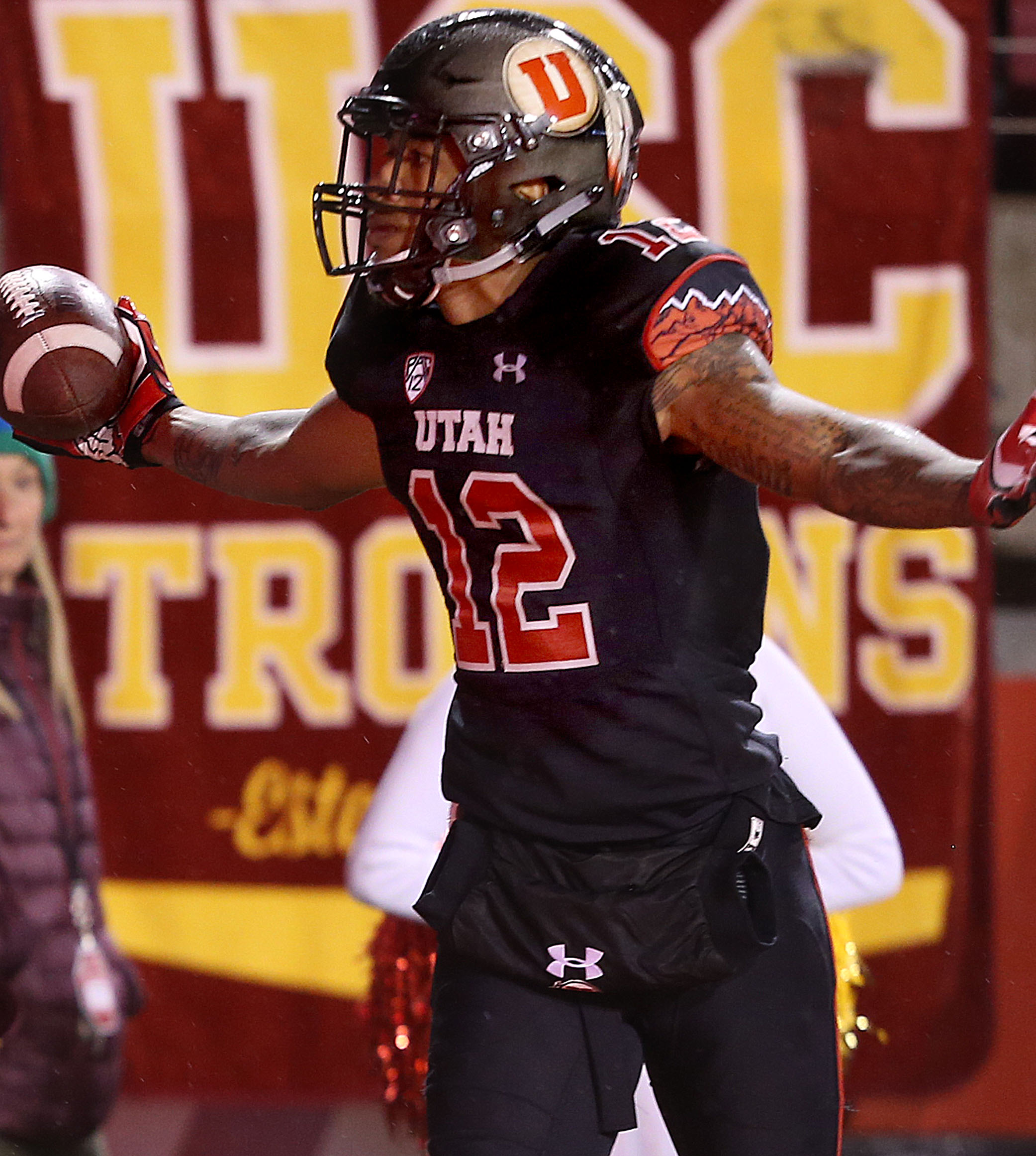 Utah Utes wide receiver Tim Patrick stands with his arms outstretched