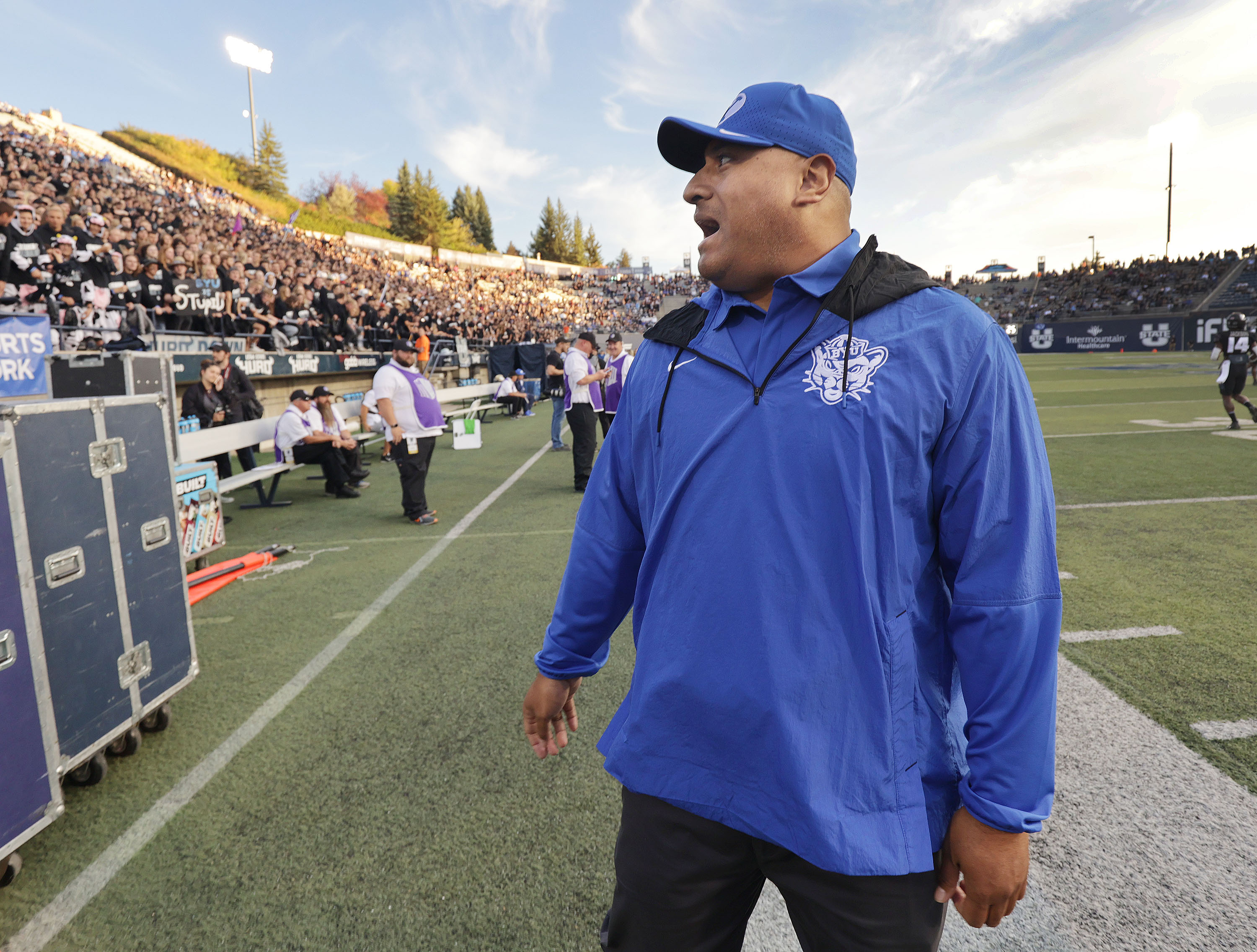 Brigham Young Cougars head coach Kalani Sitake talks with Aggie fans in Logan on Friday, Oct. 1, 2021.