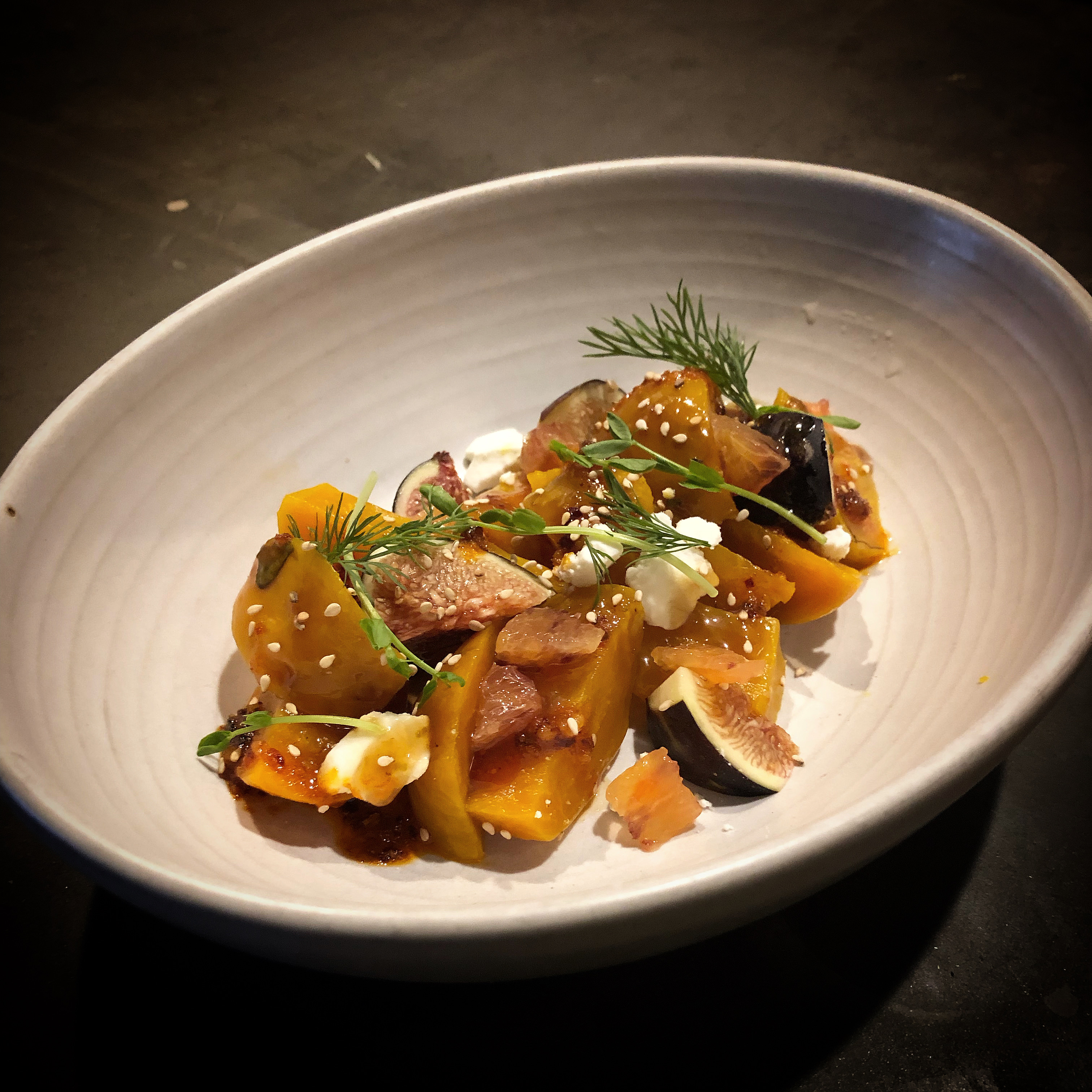 A plate of golden beets, figs, sesame seeds, and goat cheese at Chelo, a pop-up based at Magna in Portland, Oregon.
