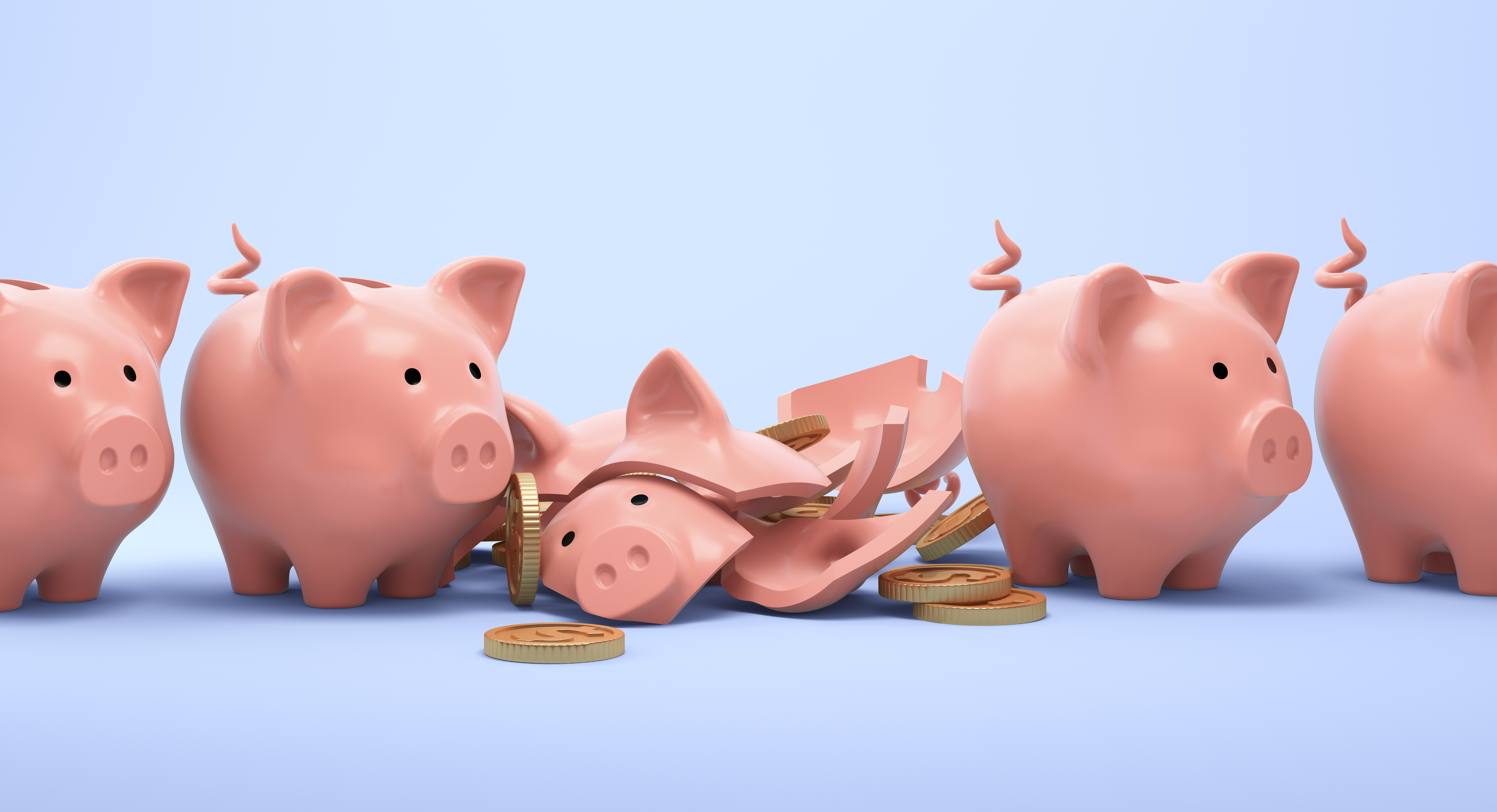 A broken piggy bank with unbroken ones to either side of it.