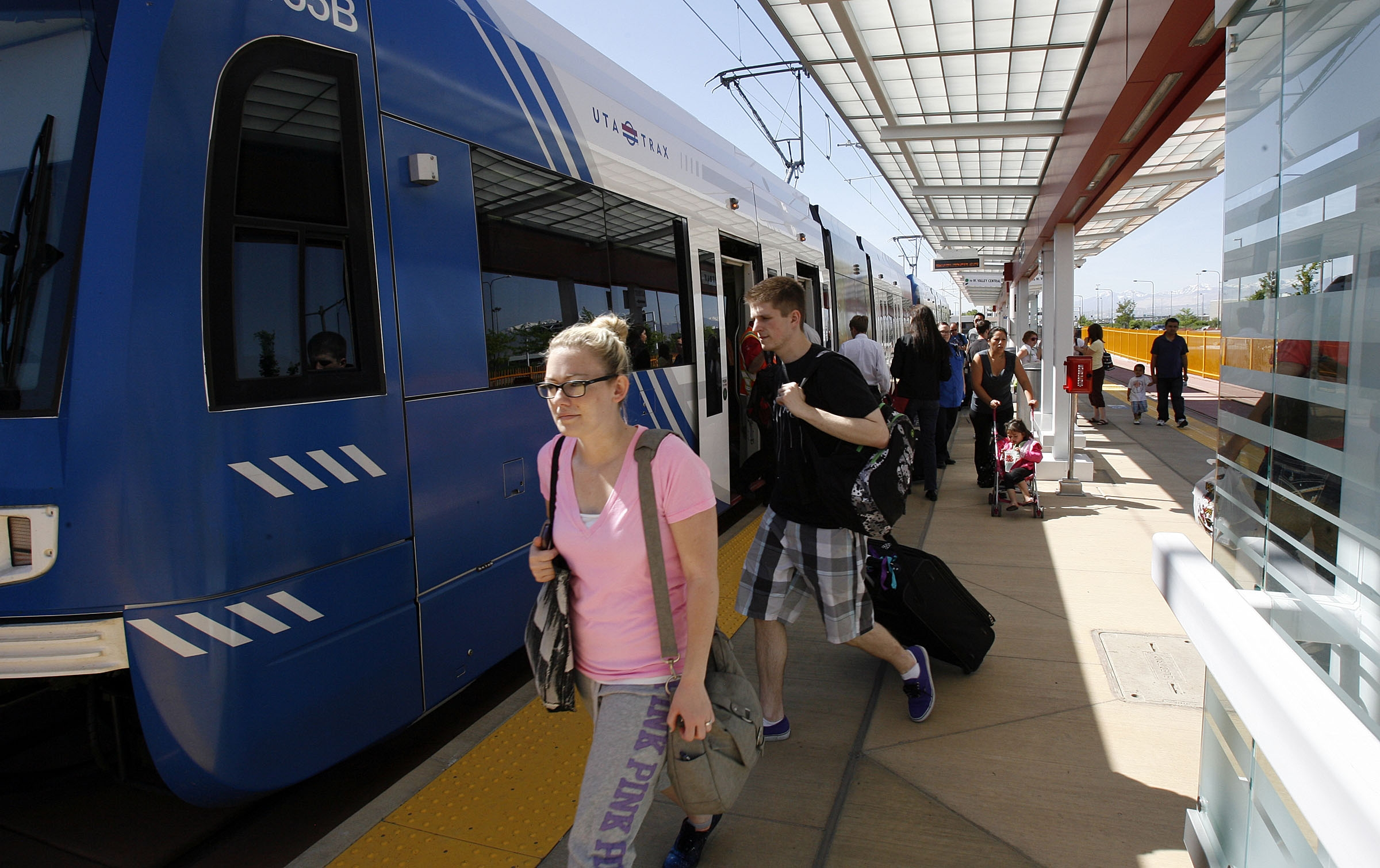 Passengers arrive by TRAX train at the Salt Lake City International Airport on May 13, 2013.