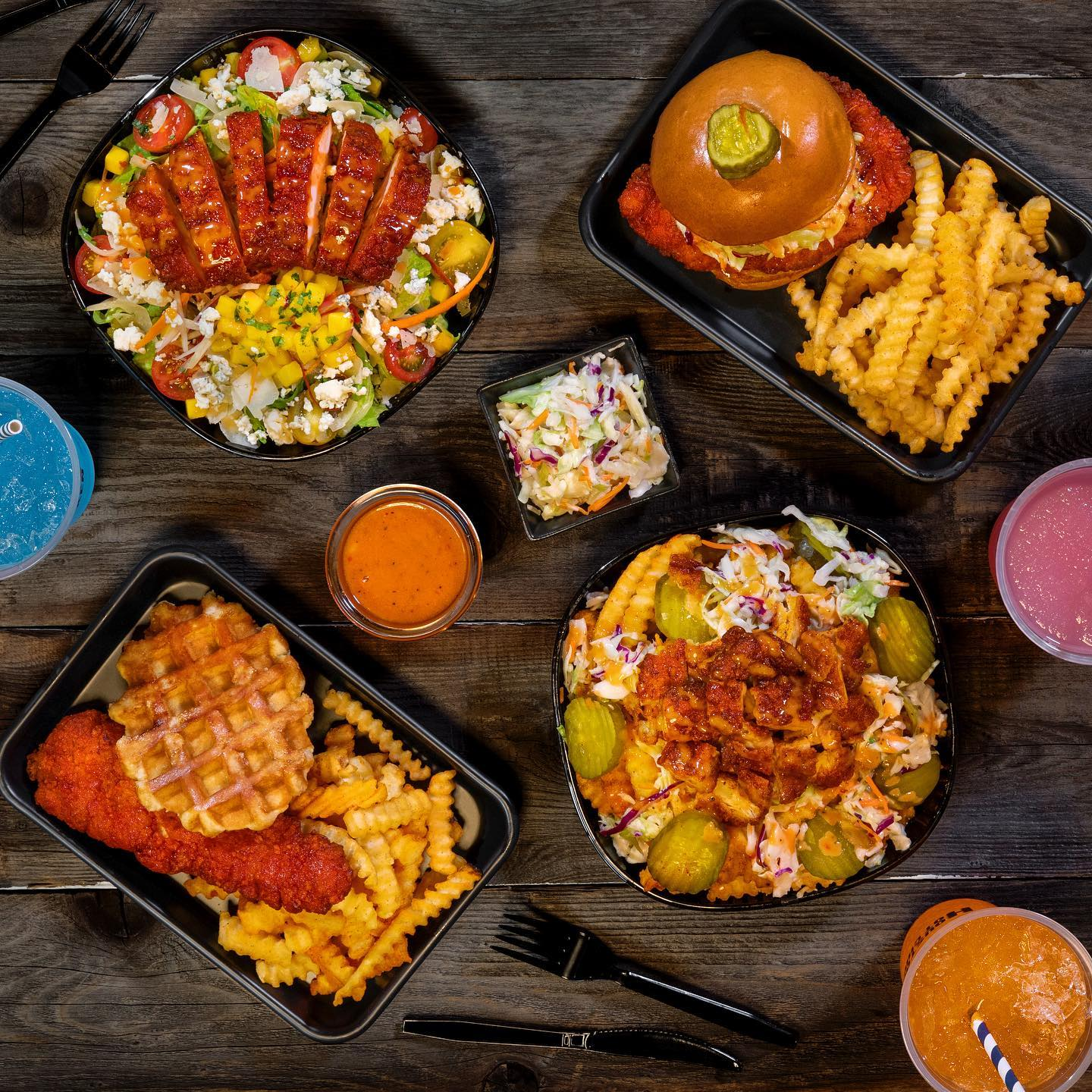 Nashville hot chicken with waffles, in a salad, as a sandwich, and in a bowl, shot from overhead.