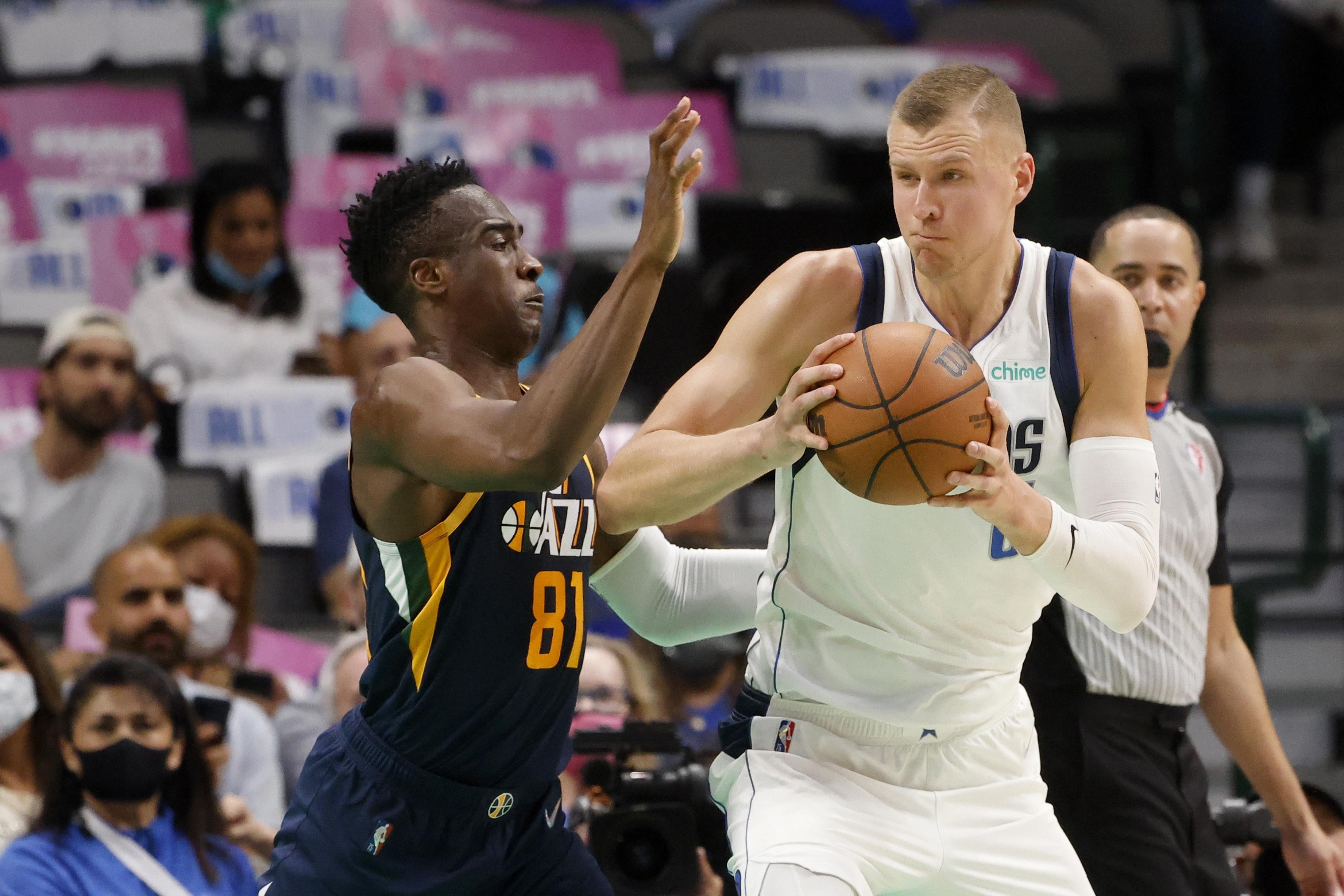 Utah Jazz guard Miye Oni, left, defends as Dallas Mavericks forward Kristaps Porzingis during preseason game.