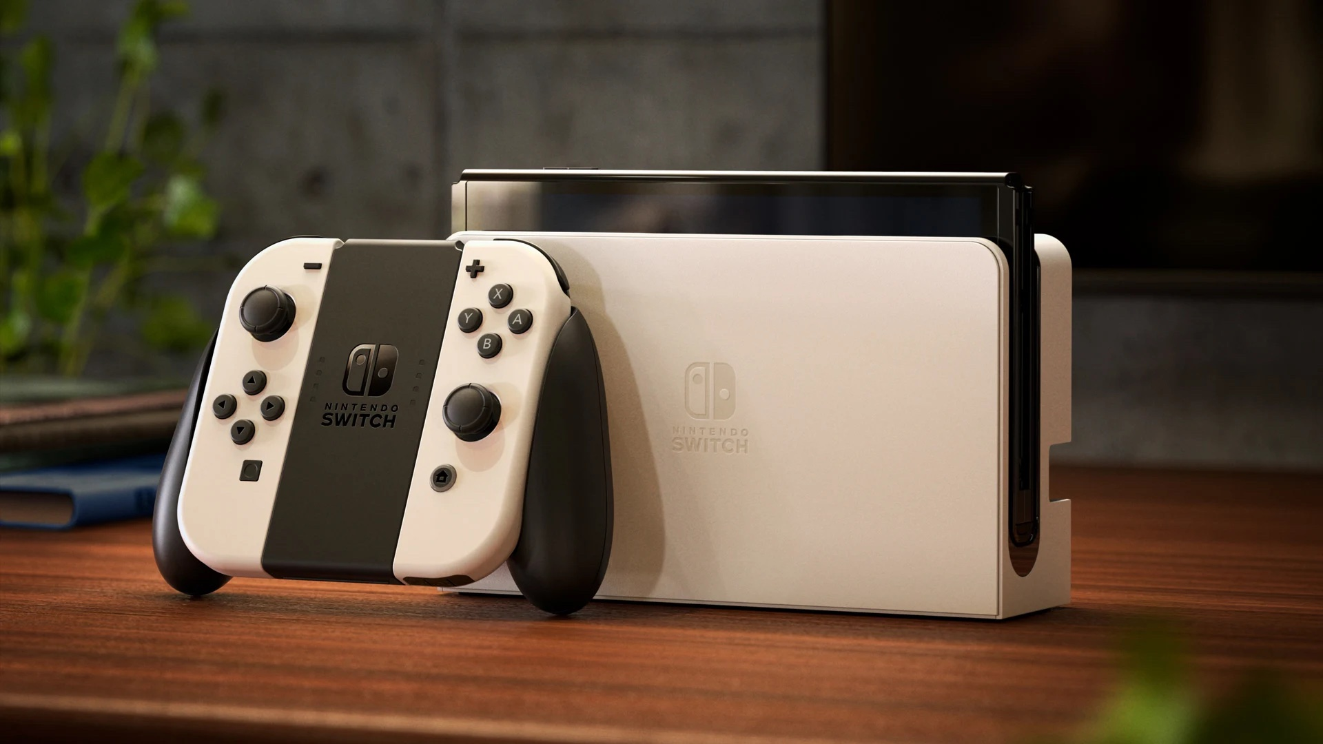 A photo of the new Nintendo Switch (OLED model) in white on a wooden table