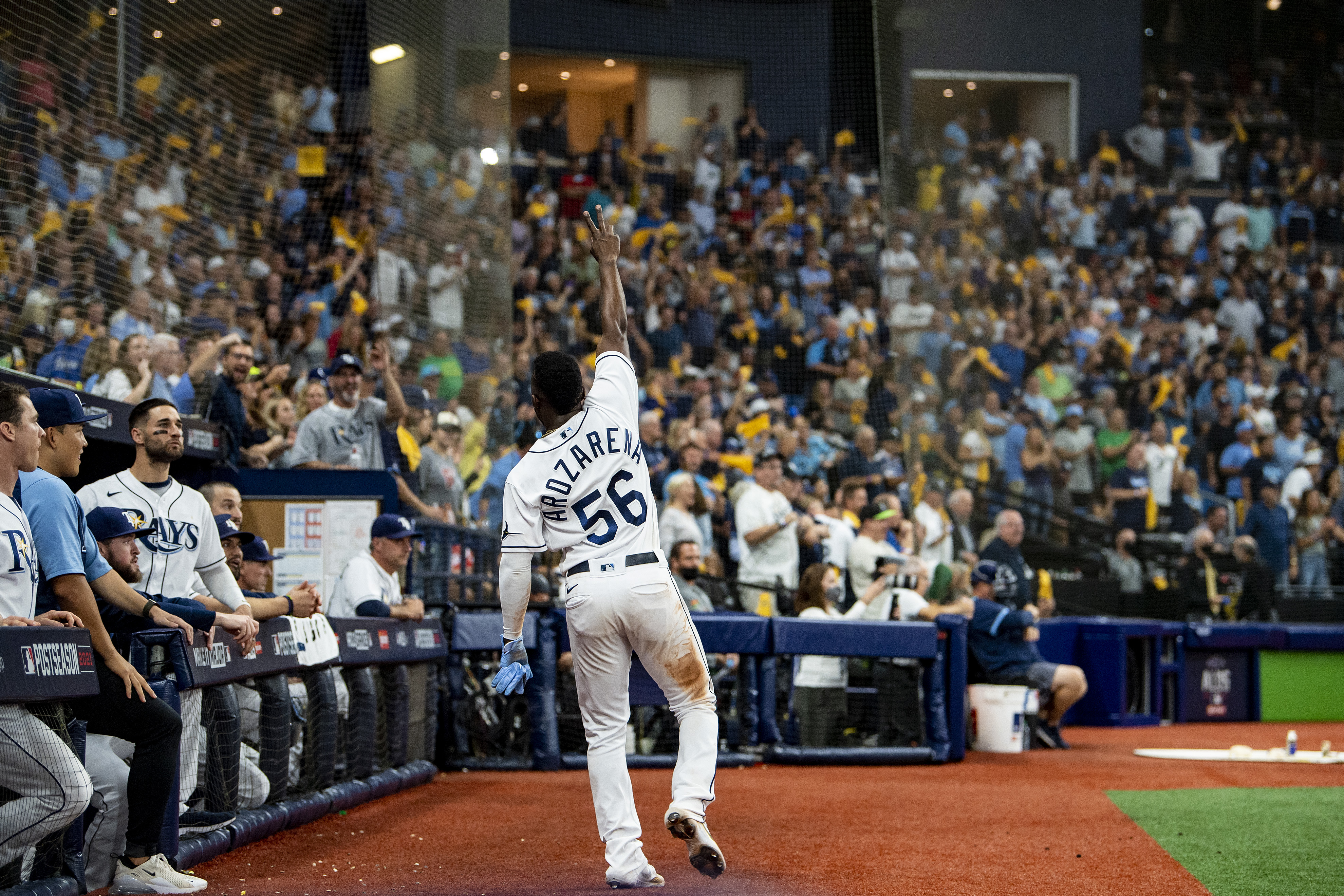 Randy Arozarena #56 of the Tampa Bay Rays gives a curtain call after stealing home plate after during the seventh inning of game one of the 2021 American League Division Series against the Boston Red Sox at Tropicana Field
