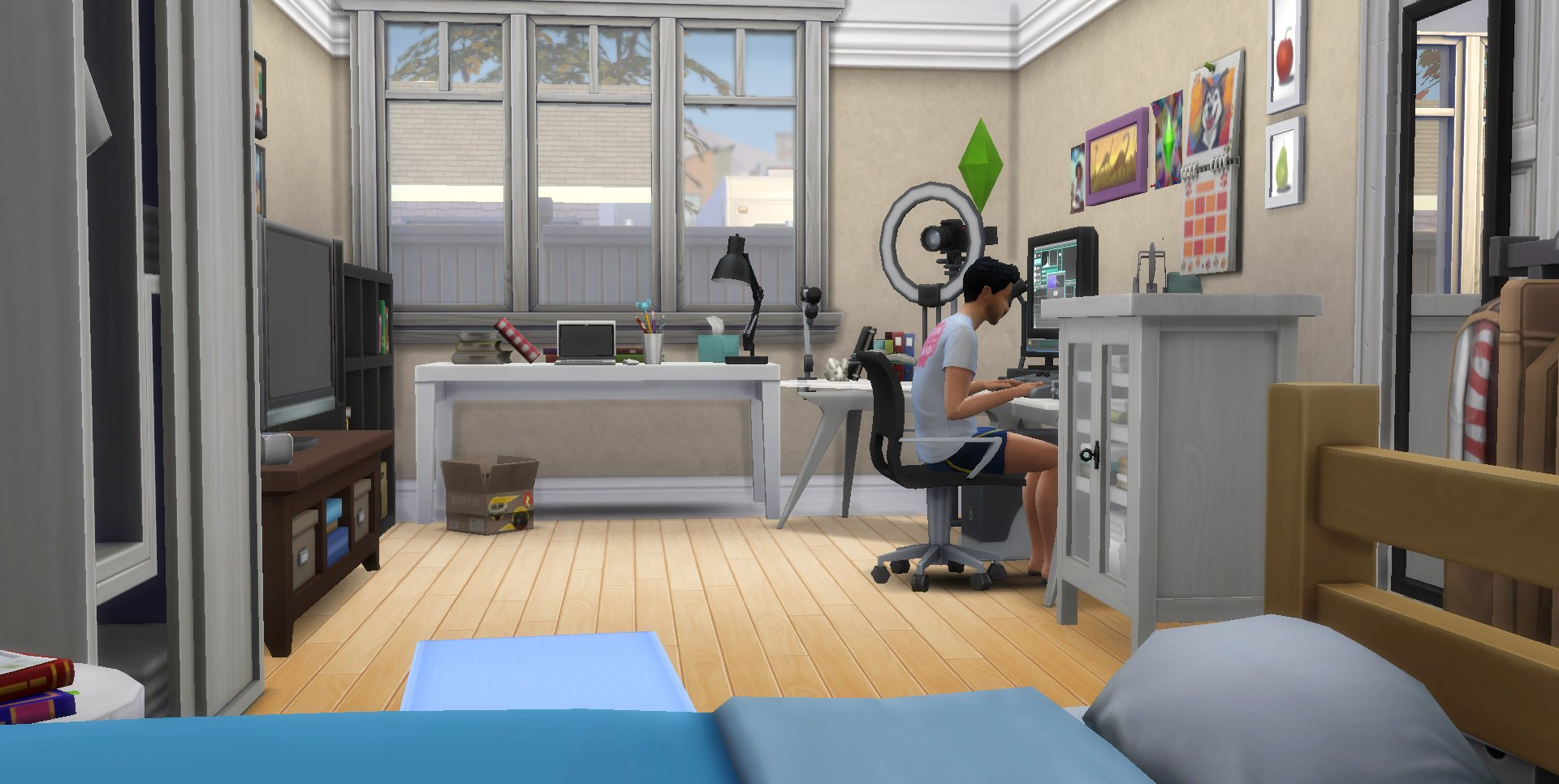 A Sims character sitting in a neat office room
