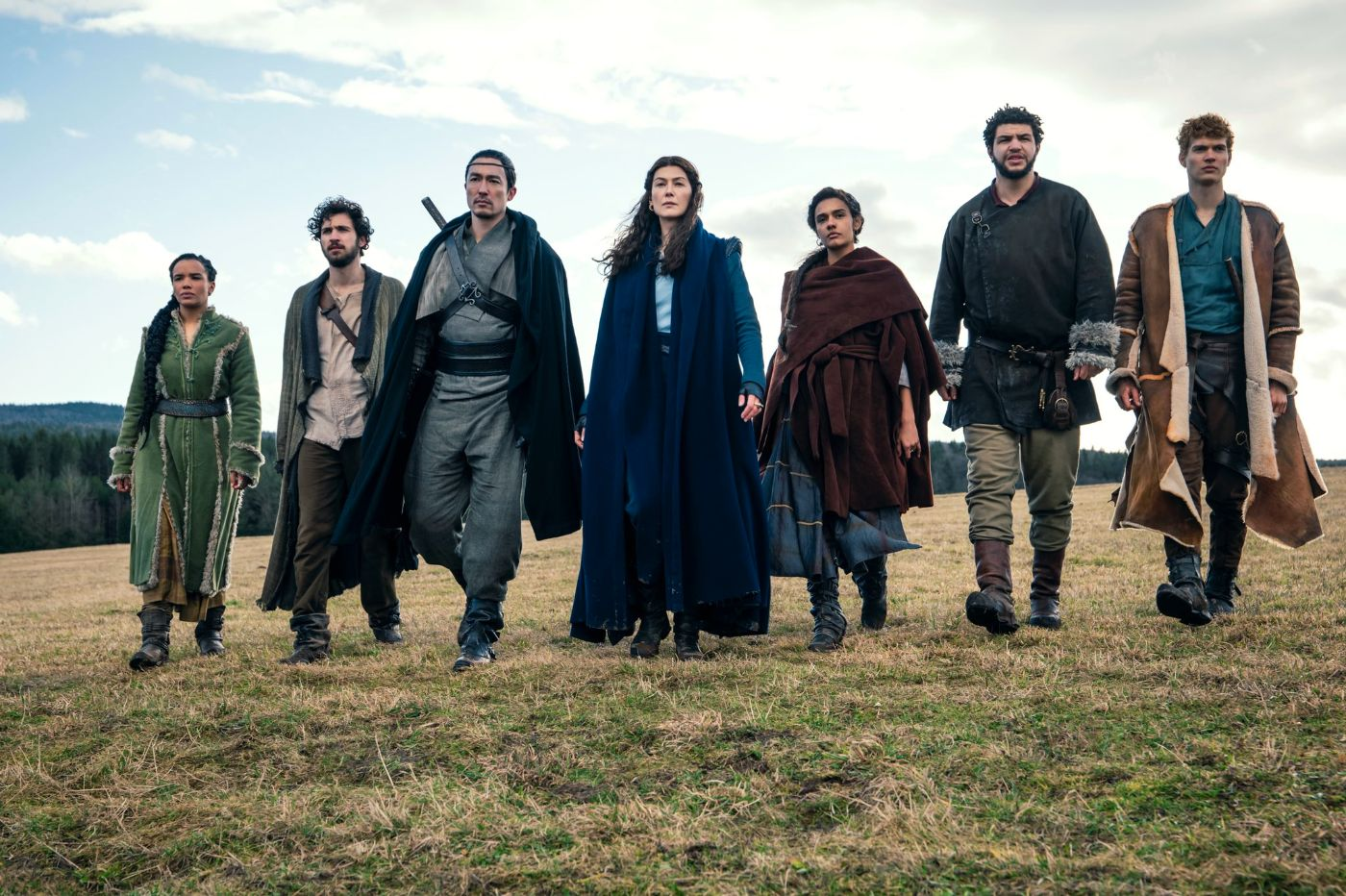 The Wheel of Time cast walks down a field