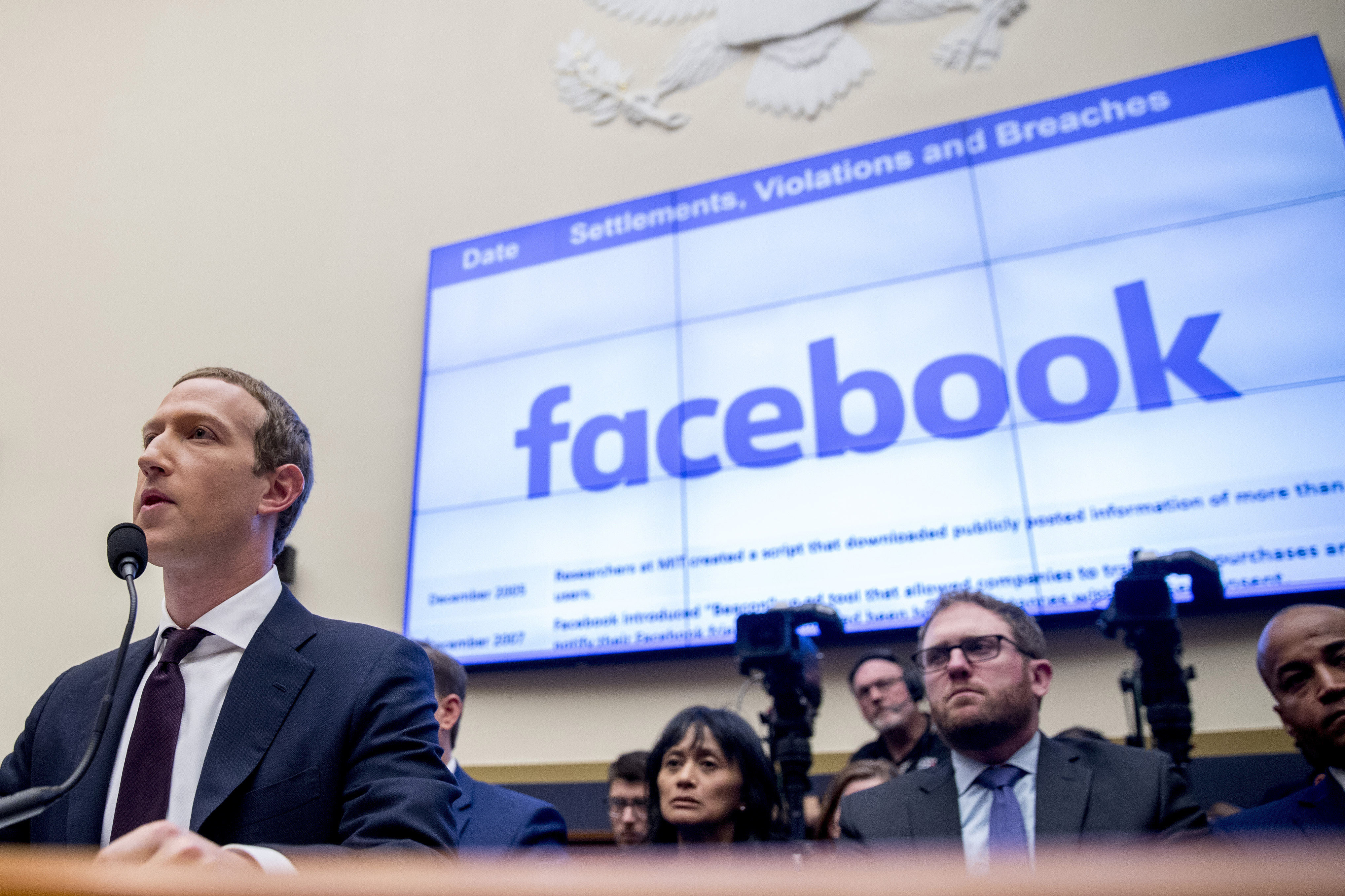 Facebook CEO Mark Zuckerberg testifies before a House Financial Services Committee hearing in Washington.