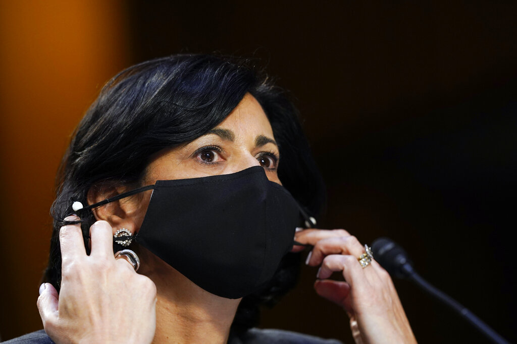 Dr. Rochelle Walensky, director of the Centers for Disease Control and Prevention, adjusts her face mask.