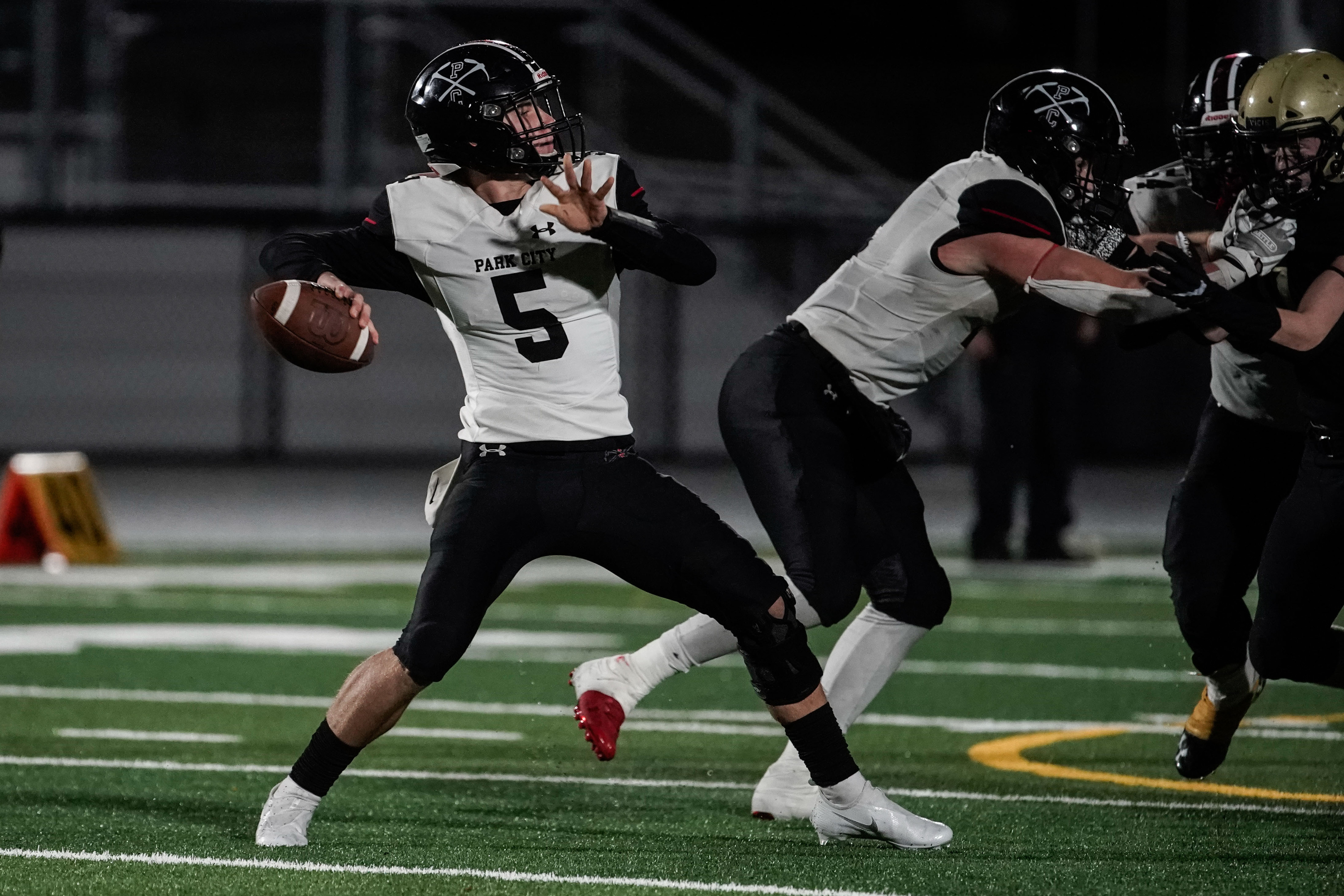 Park City's quarterback Chase Beyer looks to throw the ball as during a high school football game against Skylineat Skyline High School in Salt Lake City on Friday, Oct. 8, 2021. Skyline won 10-6.