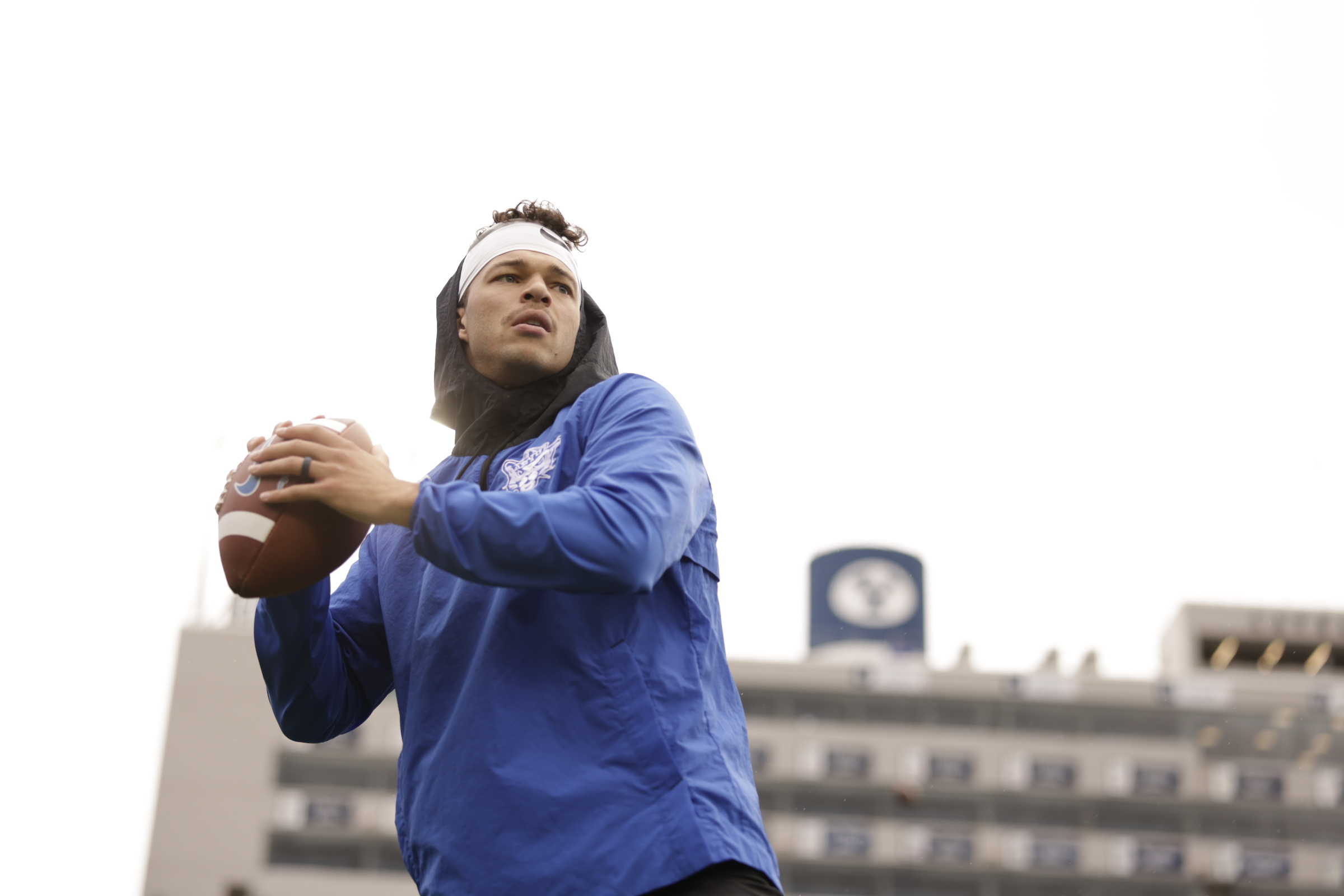 BYU quarterback Jaren Hall warms up before the Cougars' game against Boise State.