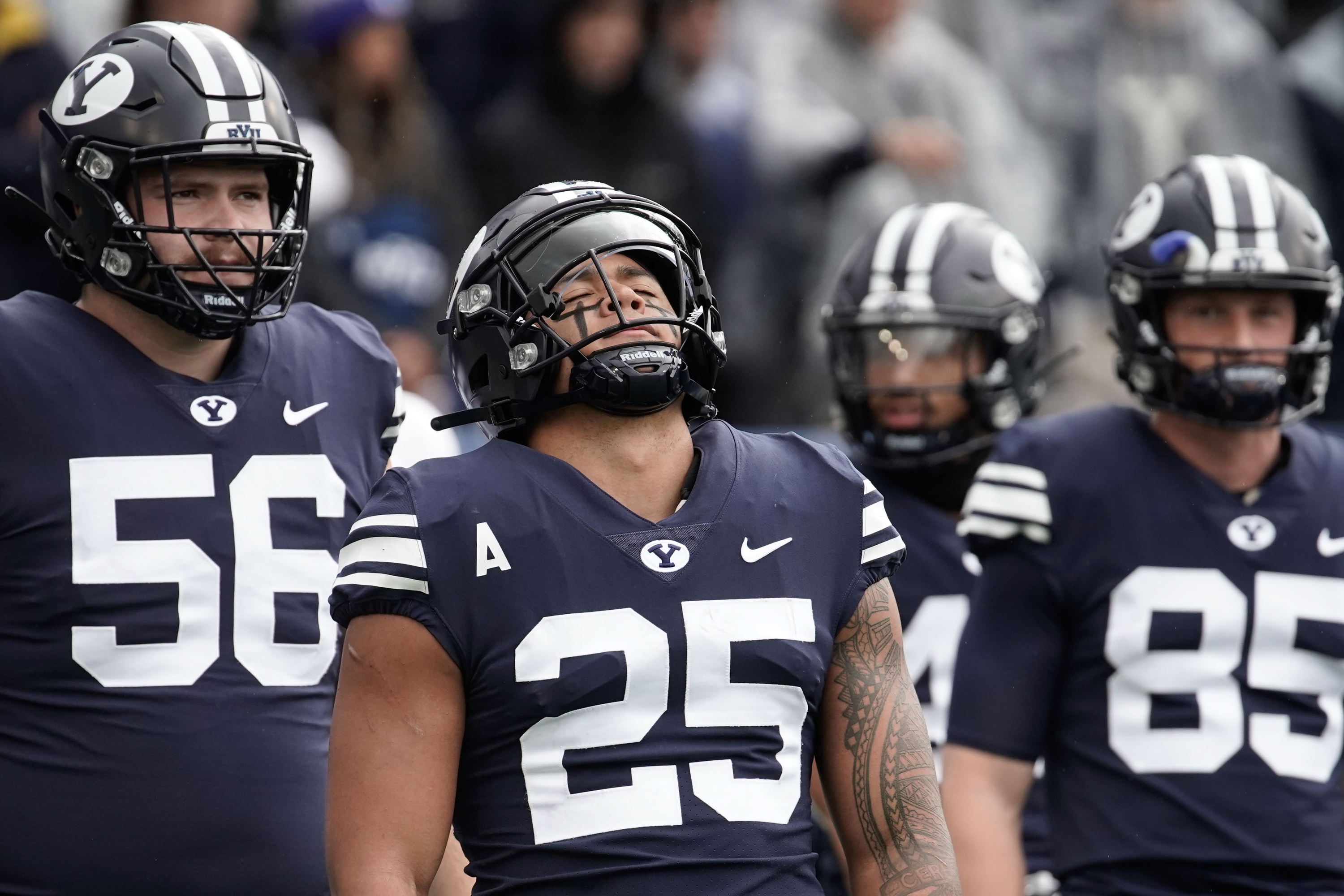 Brigham Young running back Tyler Allgeier (25) close his his eyes as he warms up ahead of an NCAA college football game against Boise State at LaVell Edwards Stadium in Provo on Saturday, Oct. 9, 2021.