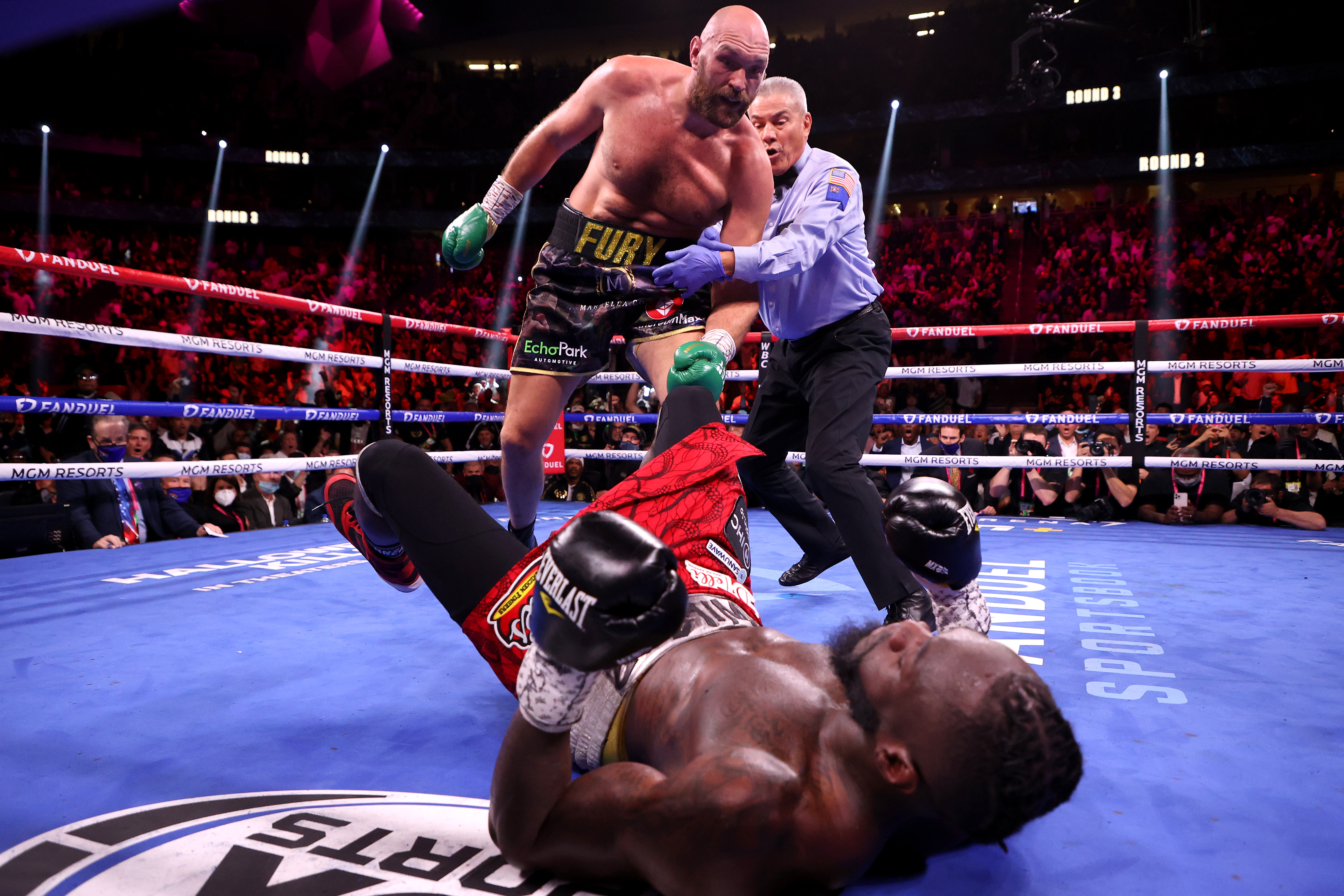 Tyson Fury scores one of his multiple knockdowns over Deontay Wilder in their 11-round classic on Saturday night.