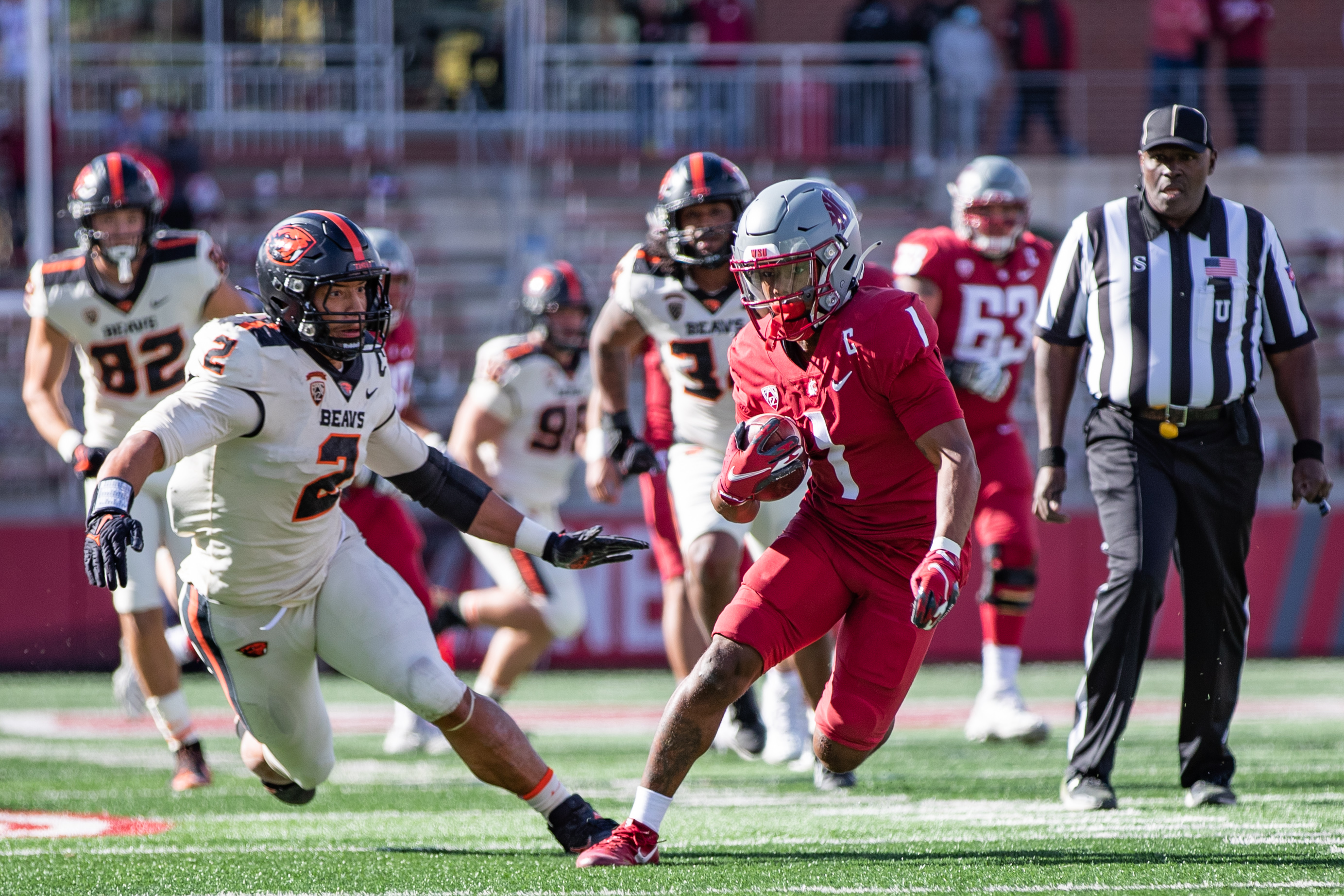 PULLMAN, WA - OCTOBER 9: Washington State receiver Travell Harris (1) runs past a defender after the catch during the first half of a PAC 12 conference matchup between the Oregon State Beavers and the Washington State Cougars on October 9, 2021, at Martin Stadium in Pullman, WA.