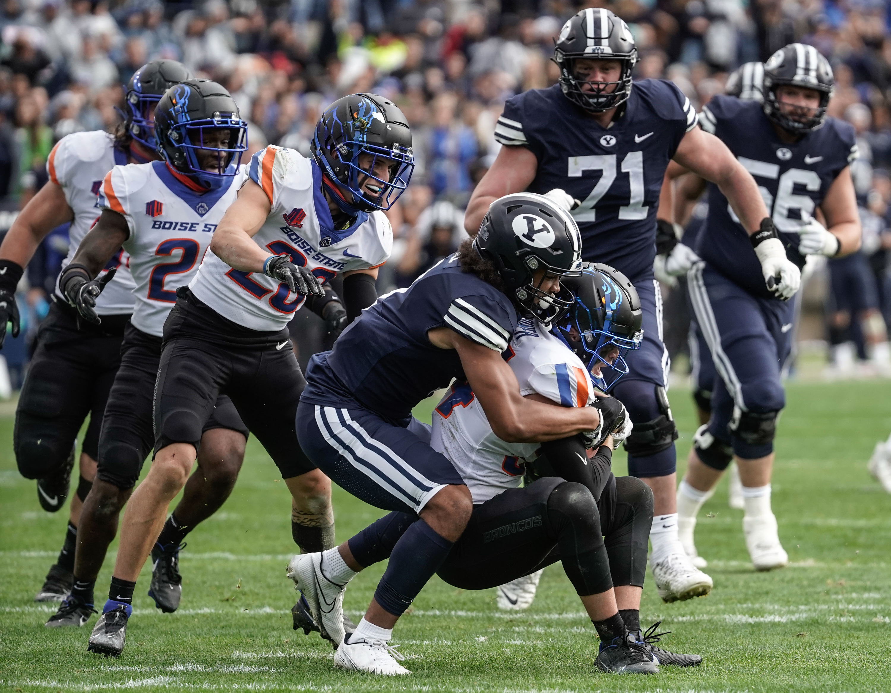 Boise State safety Alexander Teubner, right, gets tackled by BYU wide receiver Keanu Hill after Teubner recovered a BYU fumble.