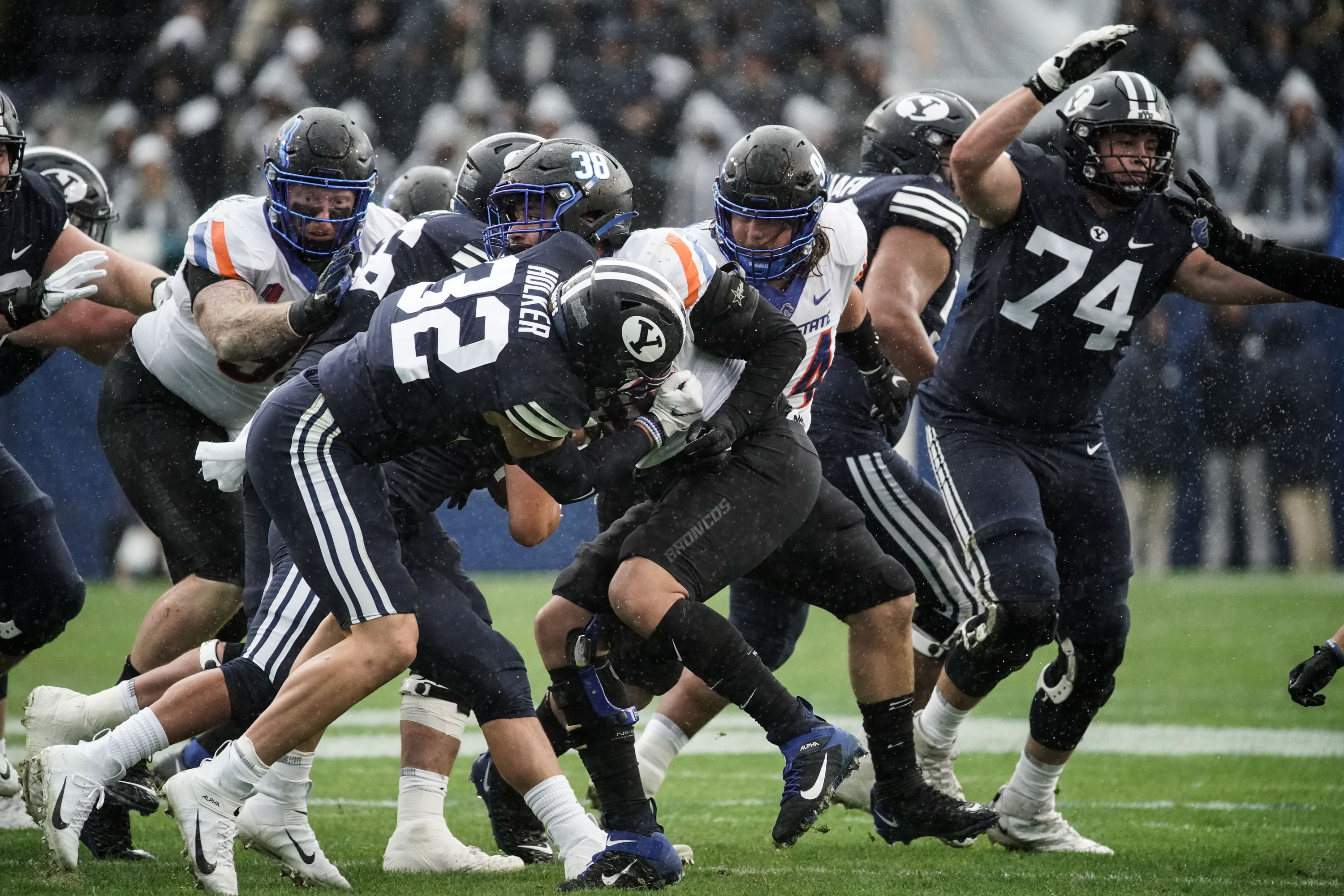 BYU and Boise State compete during an NCAA college football game.